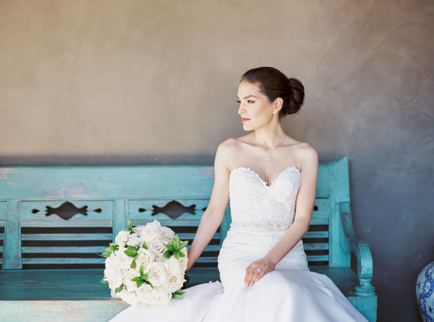 Bride on a turquoise bench captured on film, Santalux Club wedding reception, Cavin Elizabeth Photography