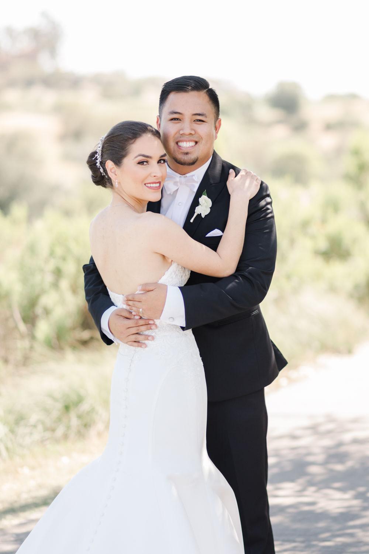 Bride and groom smiling at the camera, Santalux Club wedding reception, Cavin Elizabeth Photography