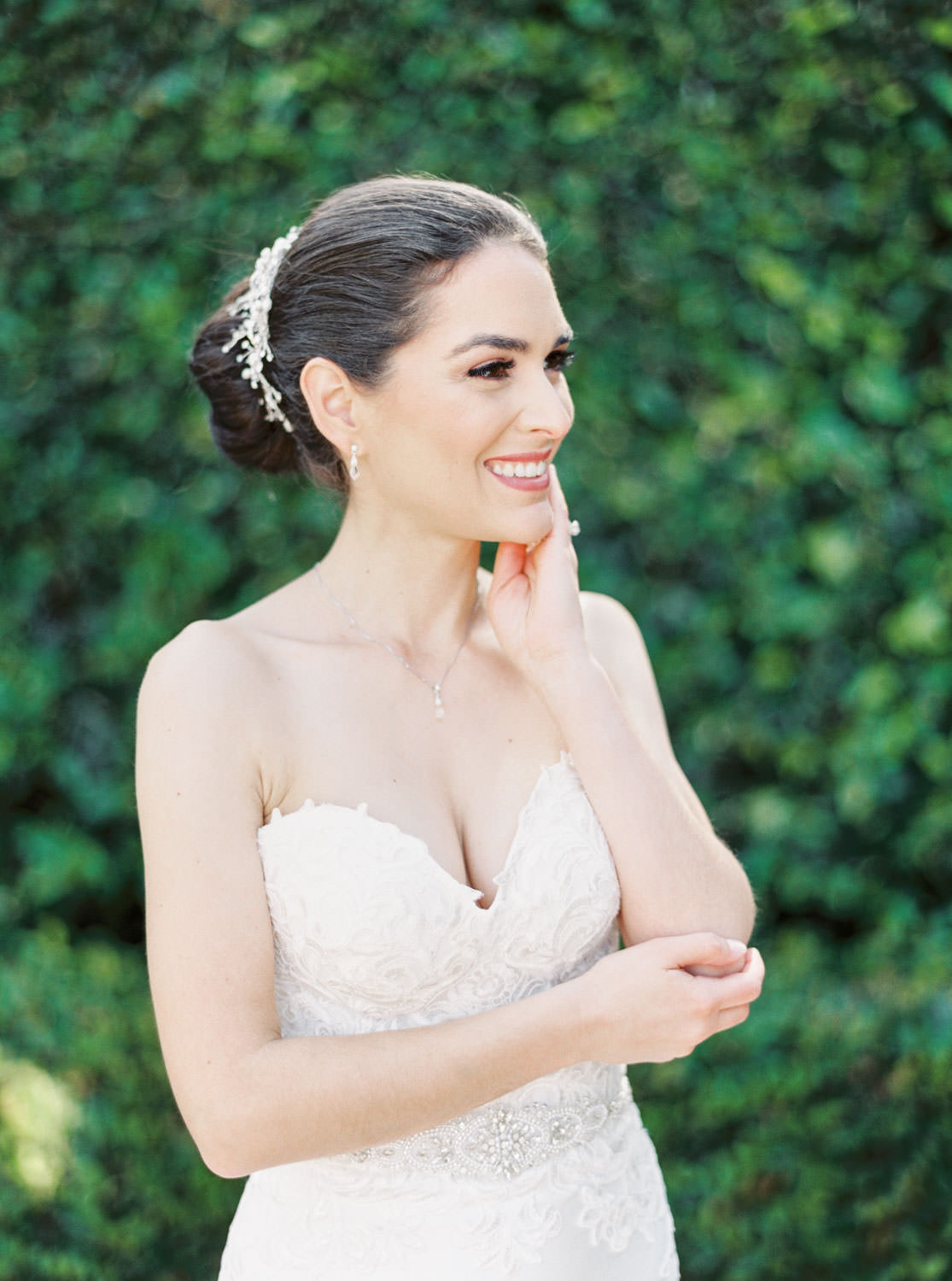 Bride captured on film in front of an ivy covered wall, Santaluz Club wedding reception, Cavin Elizabeth Photography