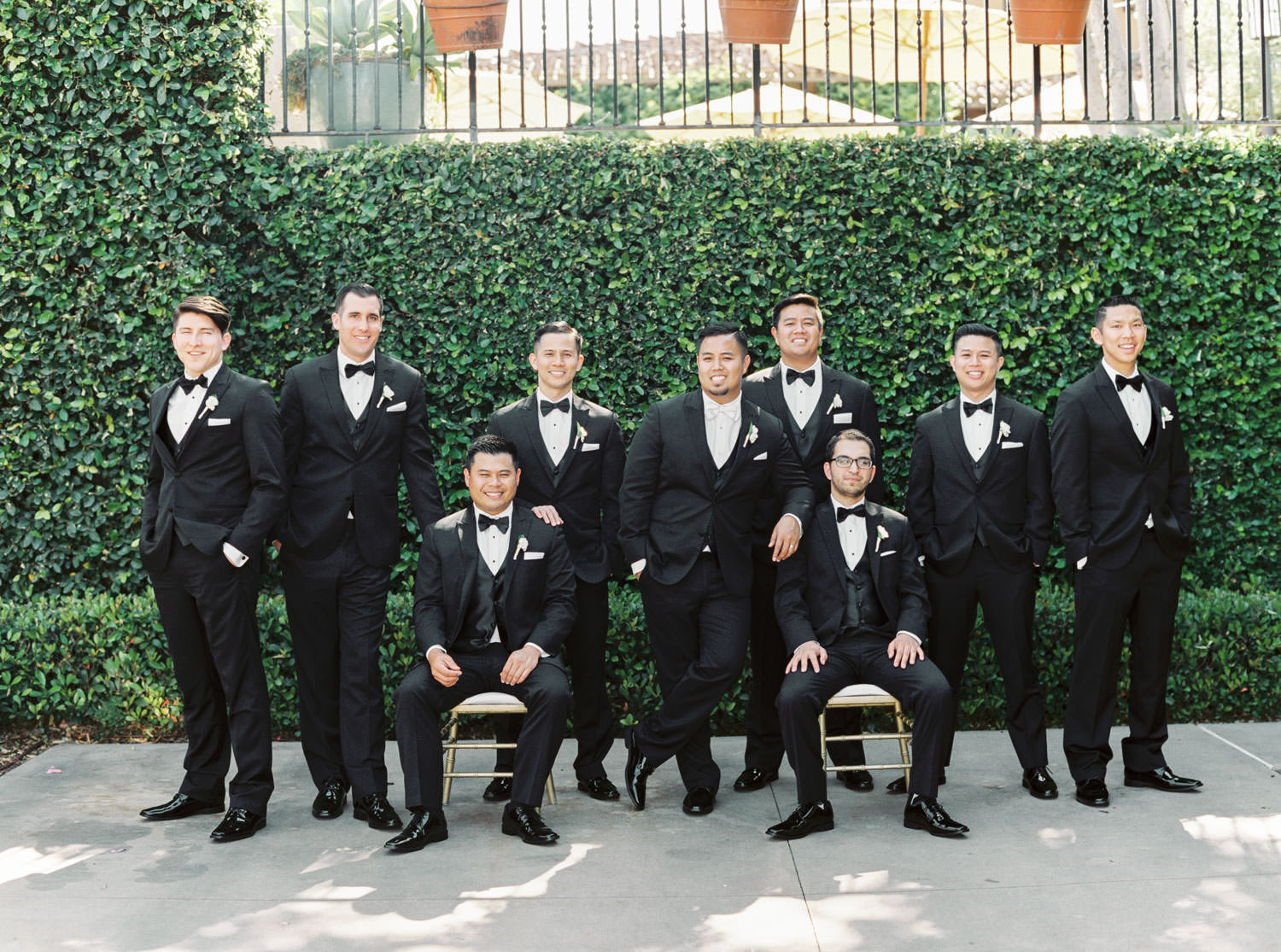 Groomsmen posed with chairs captured on film, Santalux Club wedding reception, Cavin Elizabeth Photography
