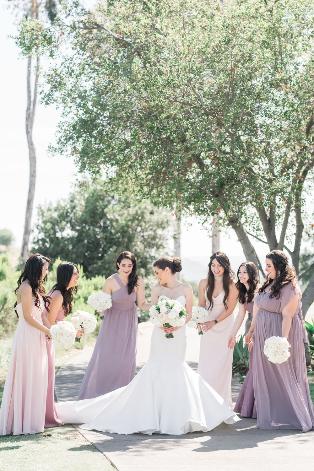 Mauve and lavender bridesmaids gown, Bride and bridesmaids fixing her gown, Santalux Club wedding reception, Cavin Elizabeth Photography