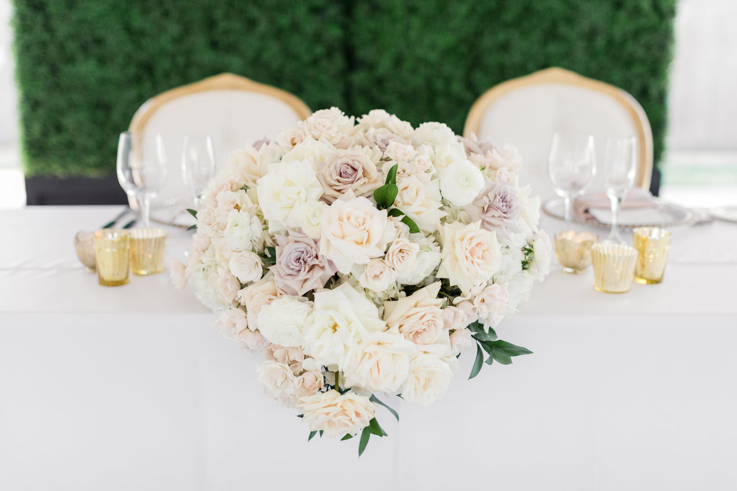 Sweetheart table with white lavender and green arrangement at Santaluz Club, Cavin Elizabeth Photography