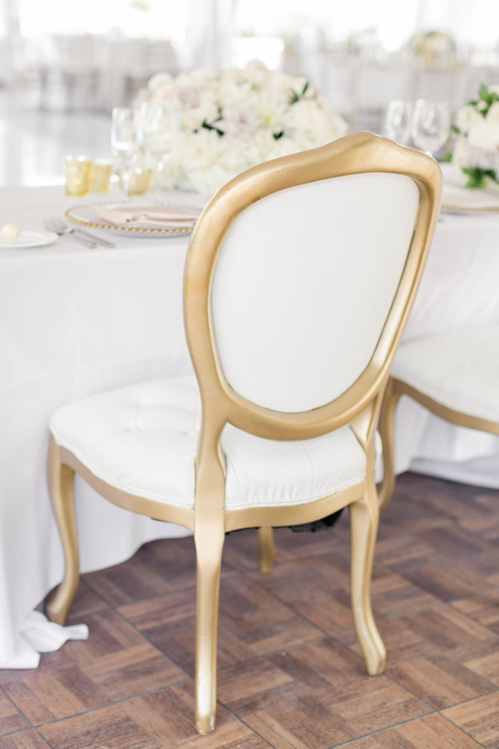 White tufted chair with gold, Cavin Elizabeth Photography