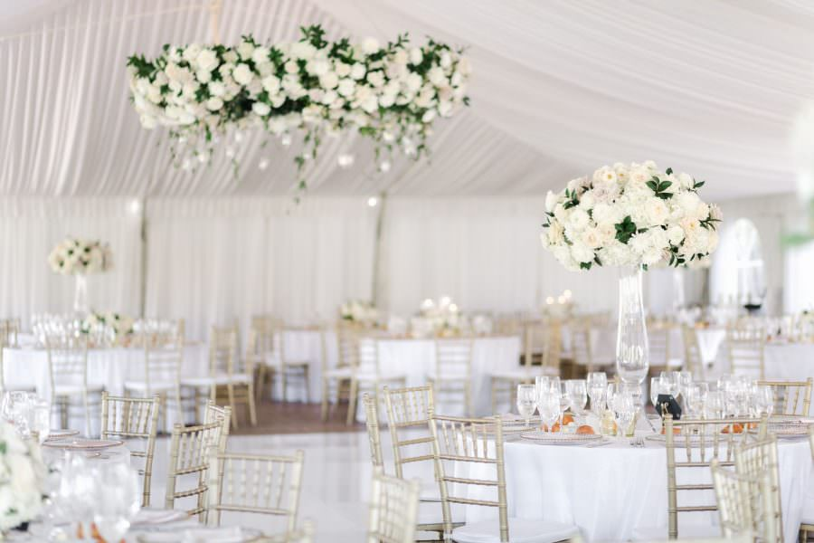 wedding reception tall centerpiece with white and green flowers at the Santaluz Club tented reception, Cavin Elizabeth Photography