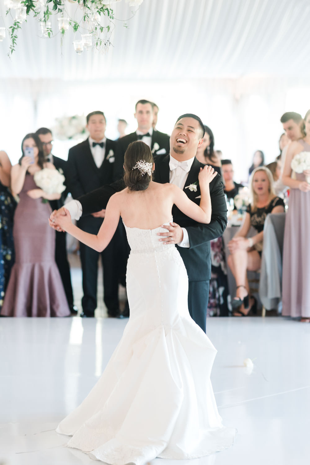 First dance with bride and groom at wedding reception tall centerpiece with white and green flowers at the Santaluz Club tented reception, Cavin Elizabeth Photography