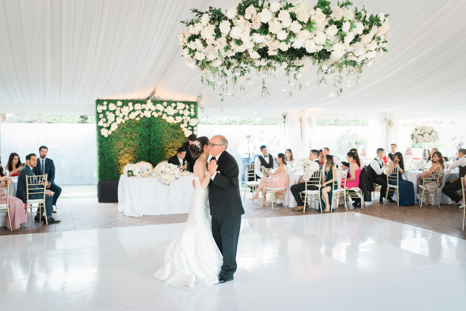 Father daughter dance with bride and dad at wedding reception tall centerpiece with white and green flowers at the Santaluz Club tented reception, Cavin Elizabeth Photography