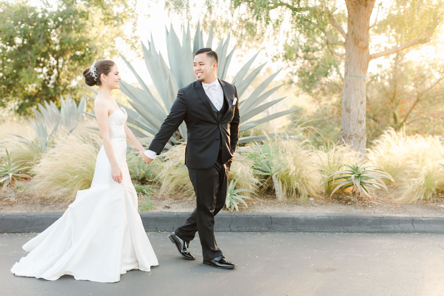 Bride and groom walking, Santalux Club wedding reception, Cavin Elizabeth Photography