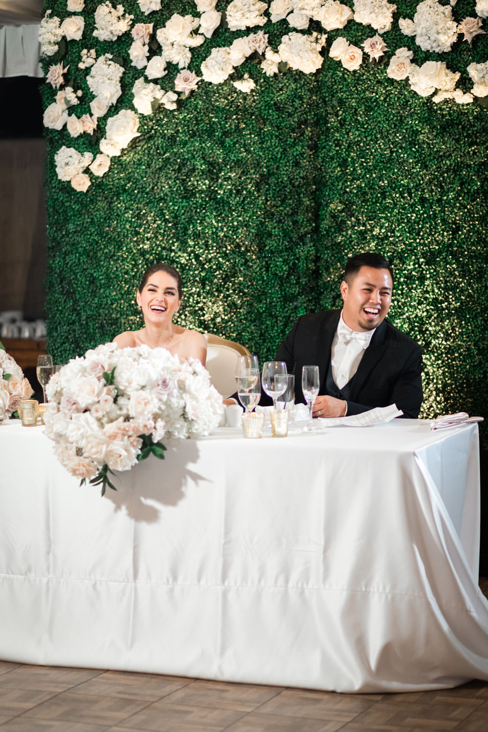 Bride and groom toast photo laughing with reception guests, Cavin Elizabeth Photography