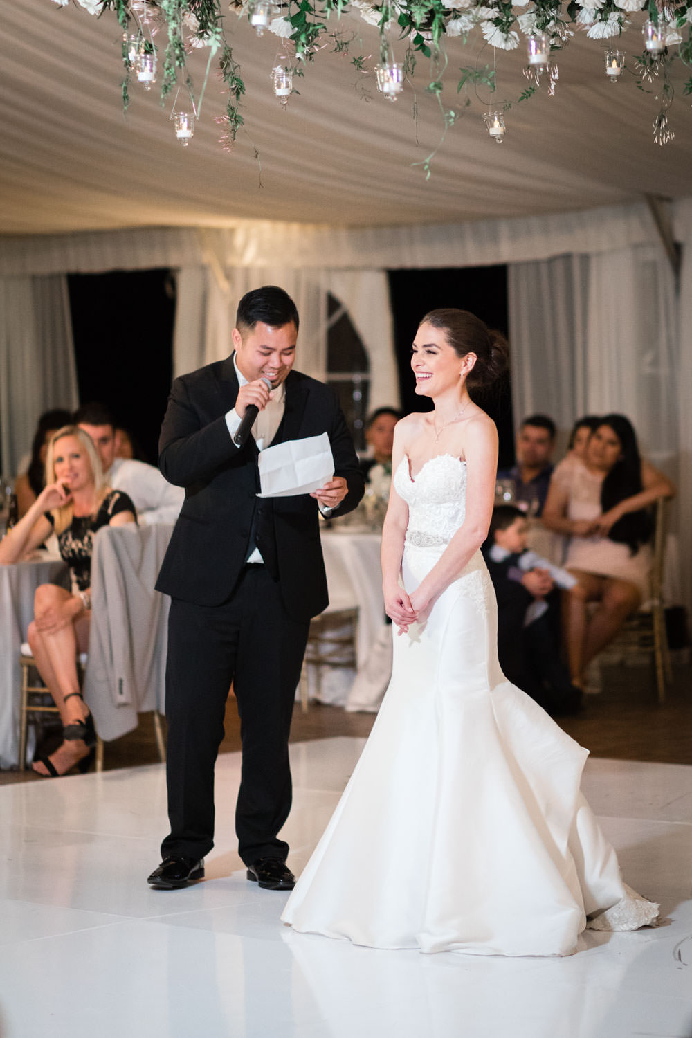 Bride and groom candid photo laughing with reception guests, Cavin Elizabeth Photography