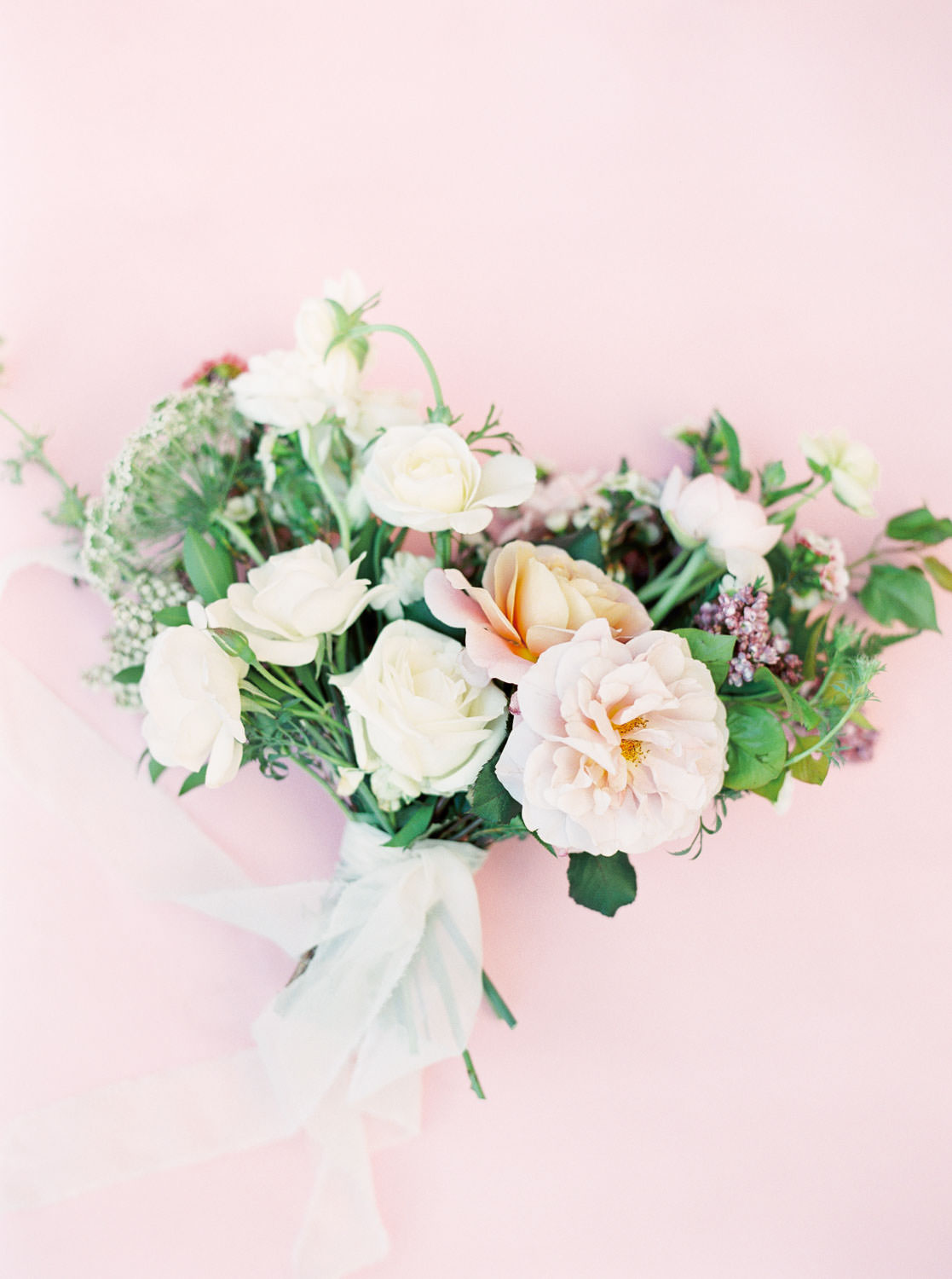 Bridal bouquet with blush peach white and green and sheer chiffon ribbons, Pink backdrop wedding editorial on medium format Contax 645 Fuji 400h film by Cavin Elizabeth Photography