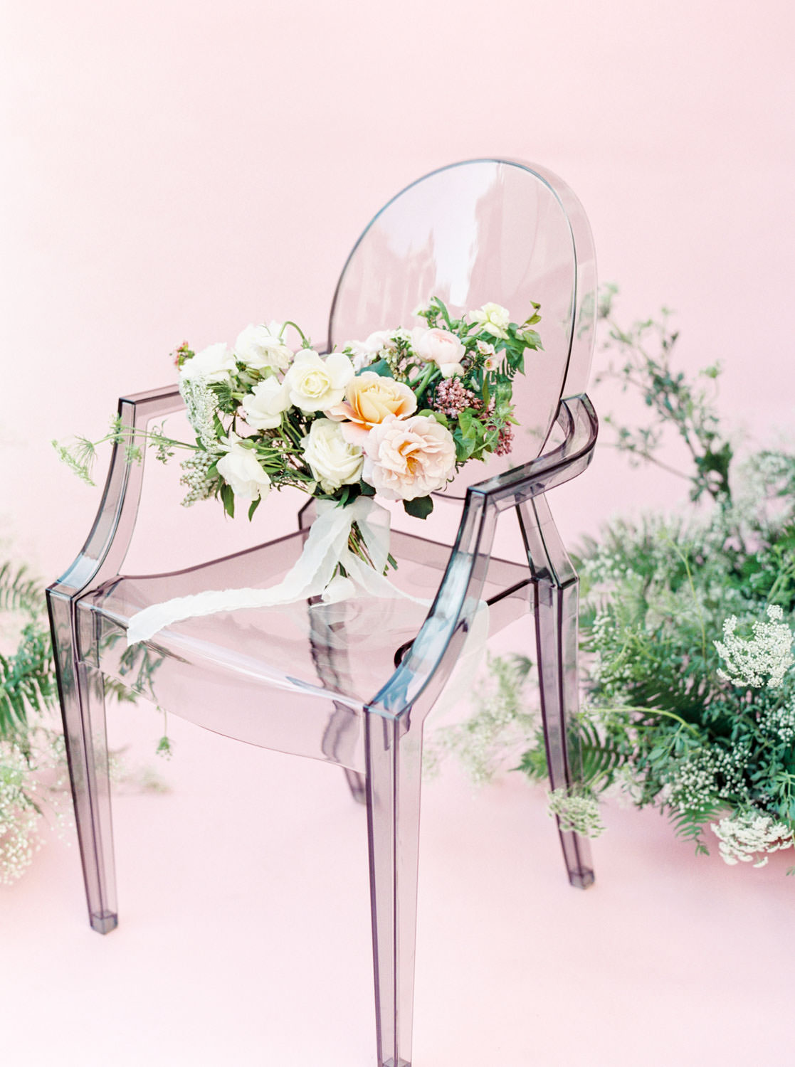 Bridal bouquet in dark ghost chair with blush peach white and green and sheer chiffon ribbons, Pink backdrop wedding editorial on medium format Contax 645 Fuji 400h film by Cavin Elizabeth Photography