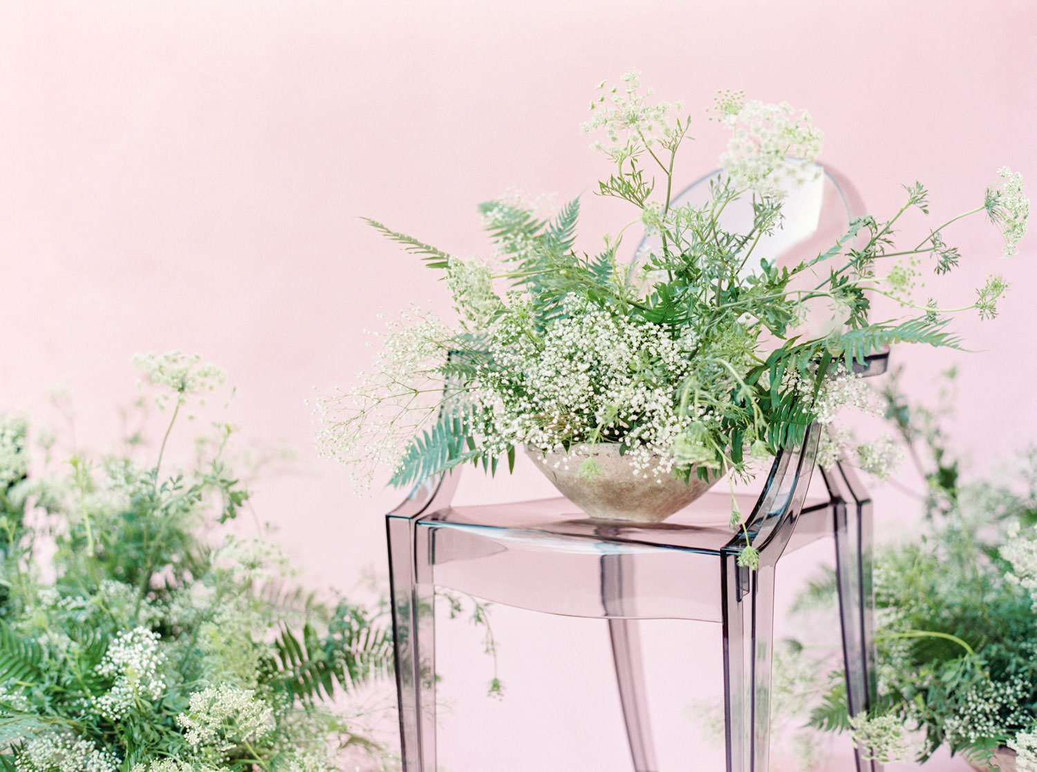 Fern and Queen Anne's lace centerpiece in dark ghost chair, Pink backdrop wedding editorial on medium format Contax 645 Fuji 400h film by Cavin Elizabeth Photography