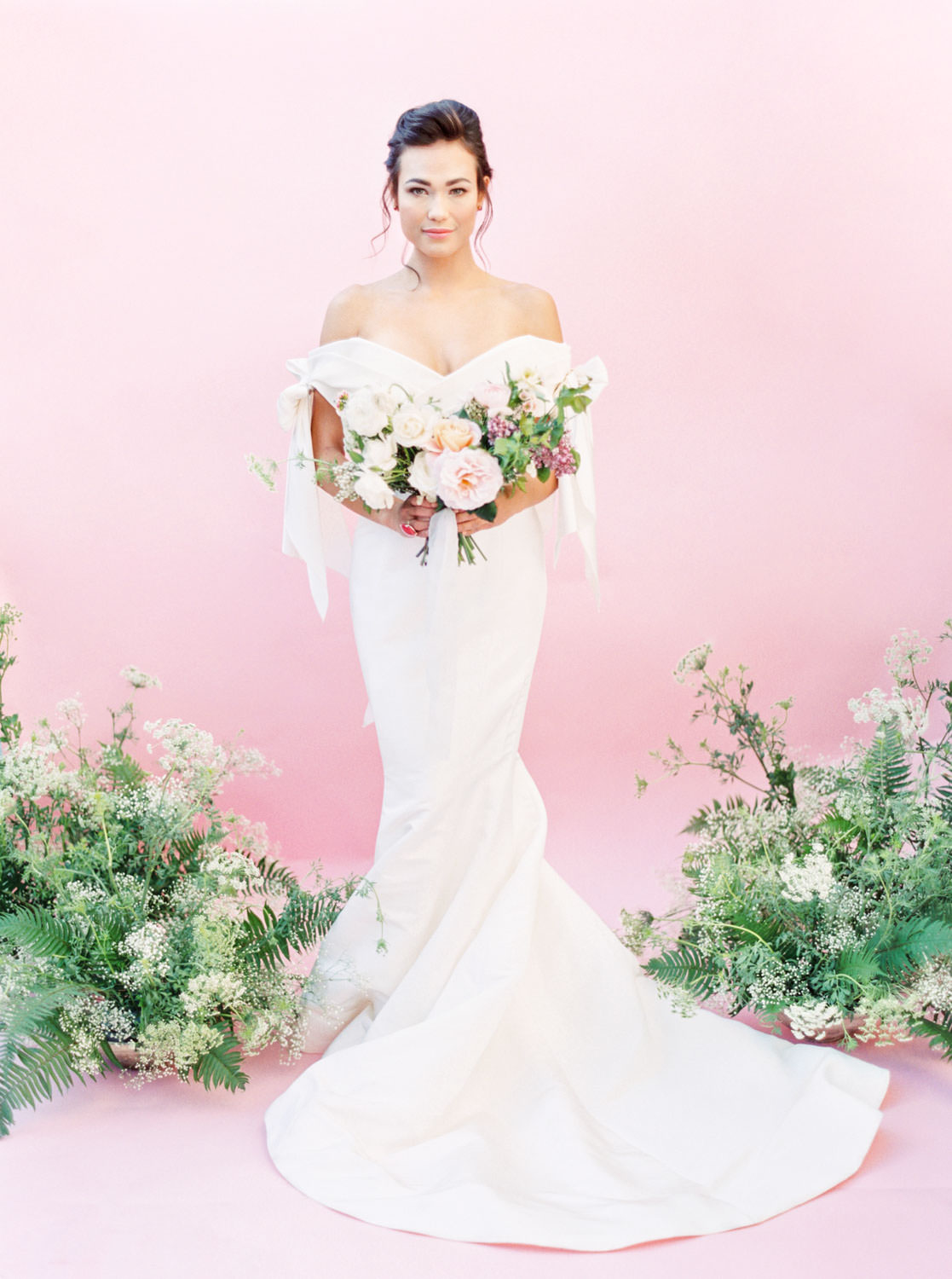Bride in Marchesa Bridal Gown Spring 2018 off shoulder bow gown with pink and green bouquet, Fern and Queen Anne's lace centerpieces, Pink backdrop wedding editorial on medium format Contax 645 Fuji 400h film by Cavin Elizabeth Photography