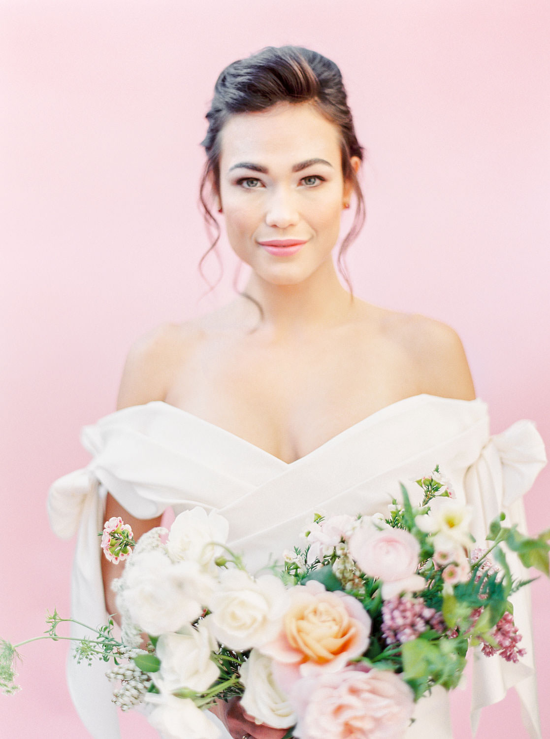 Bride in Marchesa Spring 2018 off shoulder bow gown with pink and green bouquet, Fern and Queen Anne's lace centerpieces, Pink backdrop wedding editorial on medium format Contax 645 Fuji 400h film by Cavin Elizabeth Photography