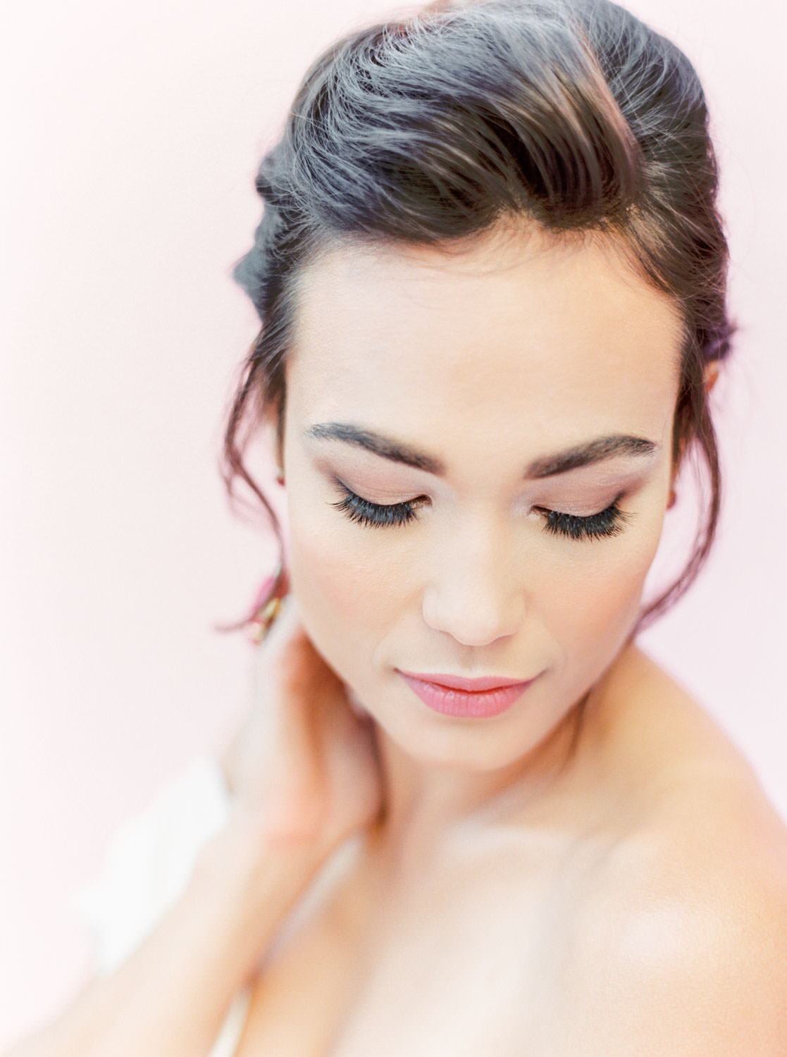 Soft bridal makeup with a pink lip, Pink backdrop wedding editorial on medium format Contax 645 Fuji 400h film by Cavin Elizabeth Photography