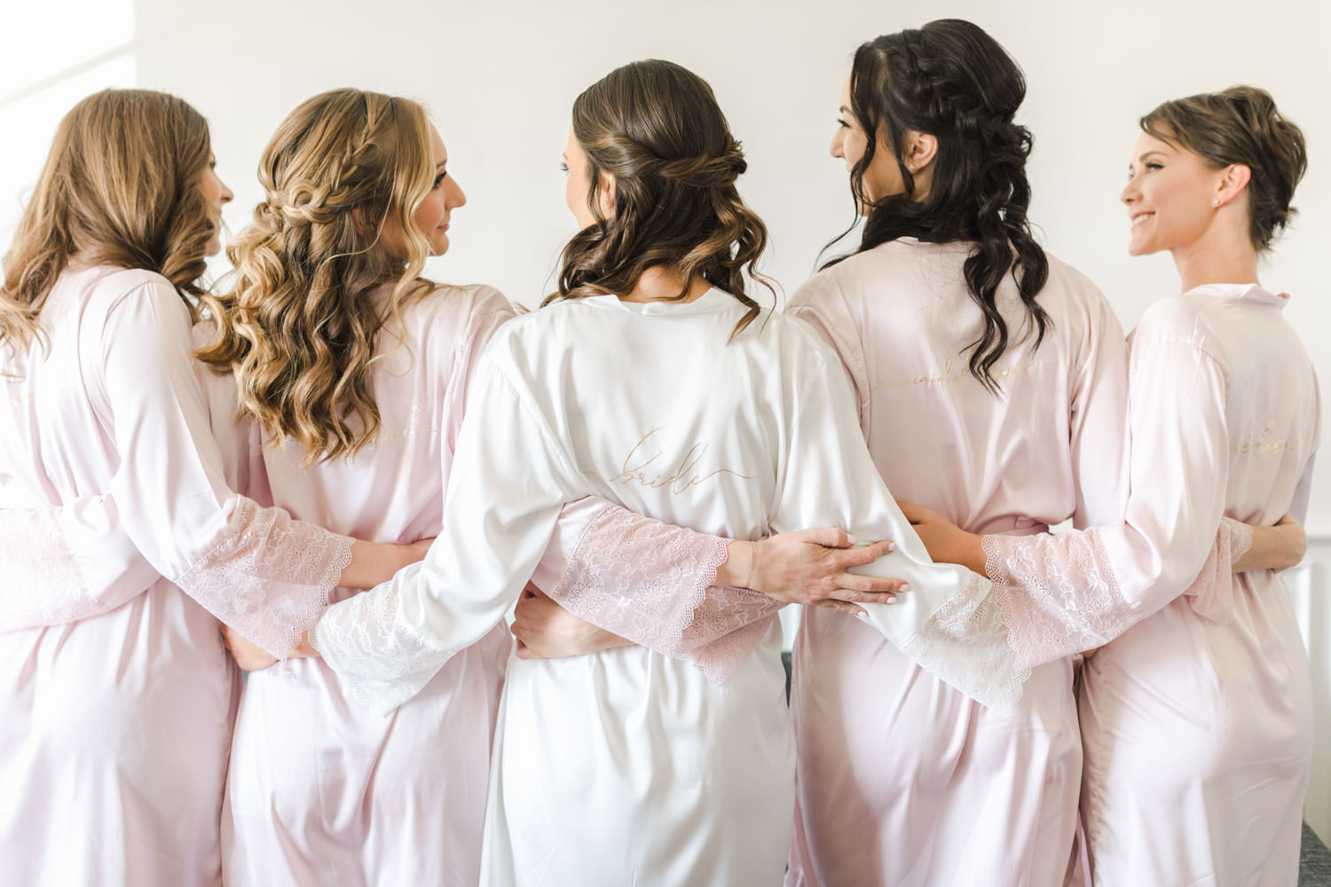 Bride with bridesmaids in robes at the Landsby Hotel, Gainey Vineyards Wedding, Cavin Elizabeth Photography