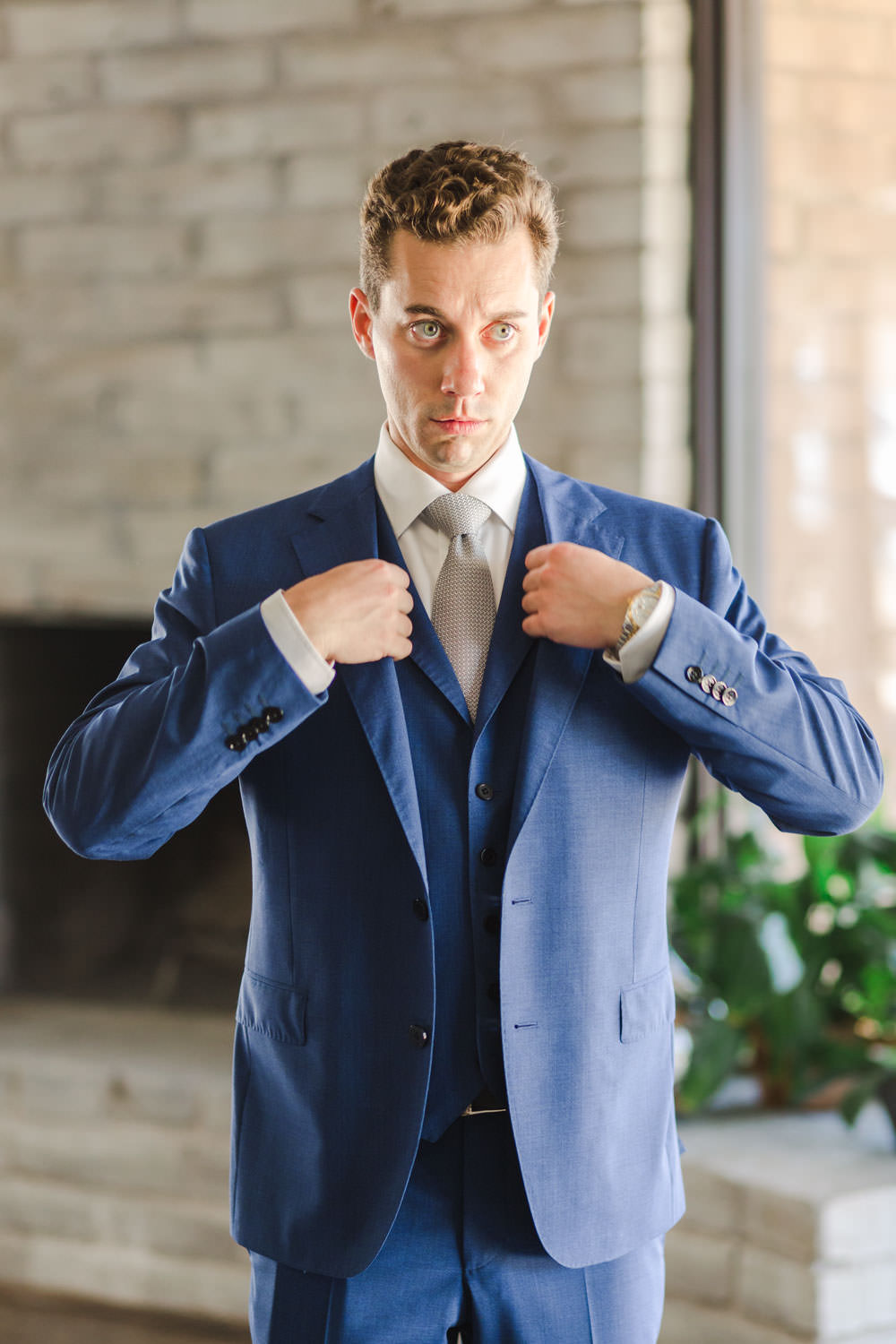 Groom in navy suit getting ready, Cavin Elizabeth Photography