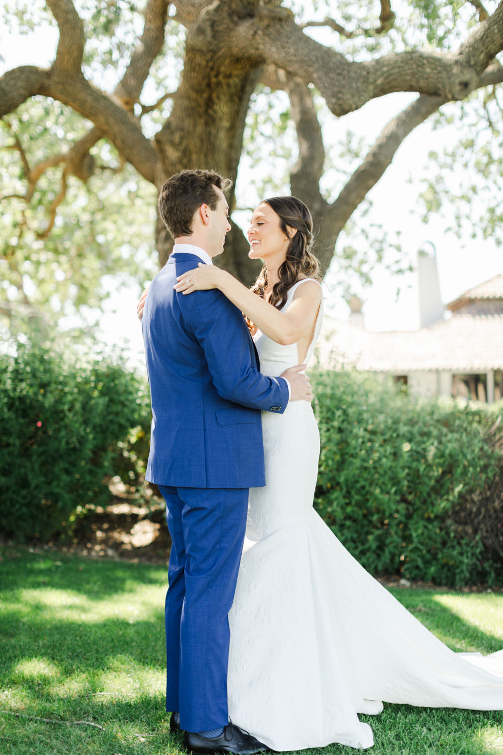 Groom in navy suit for first look with his bride, Cavin Elizabeth Photography