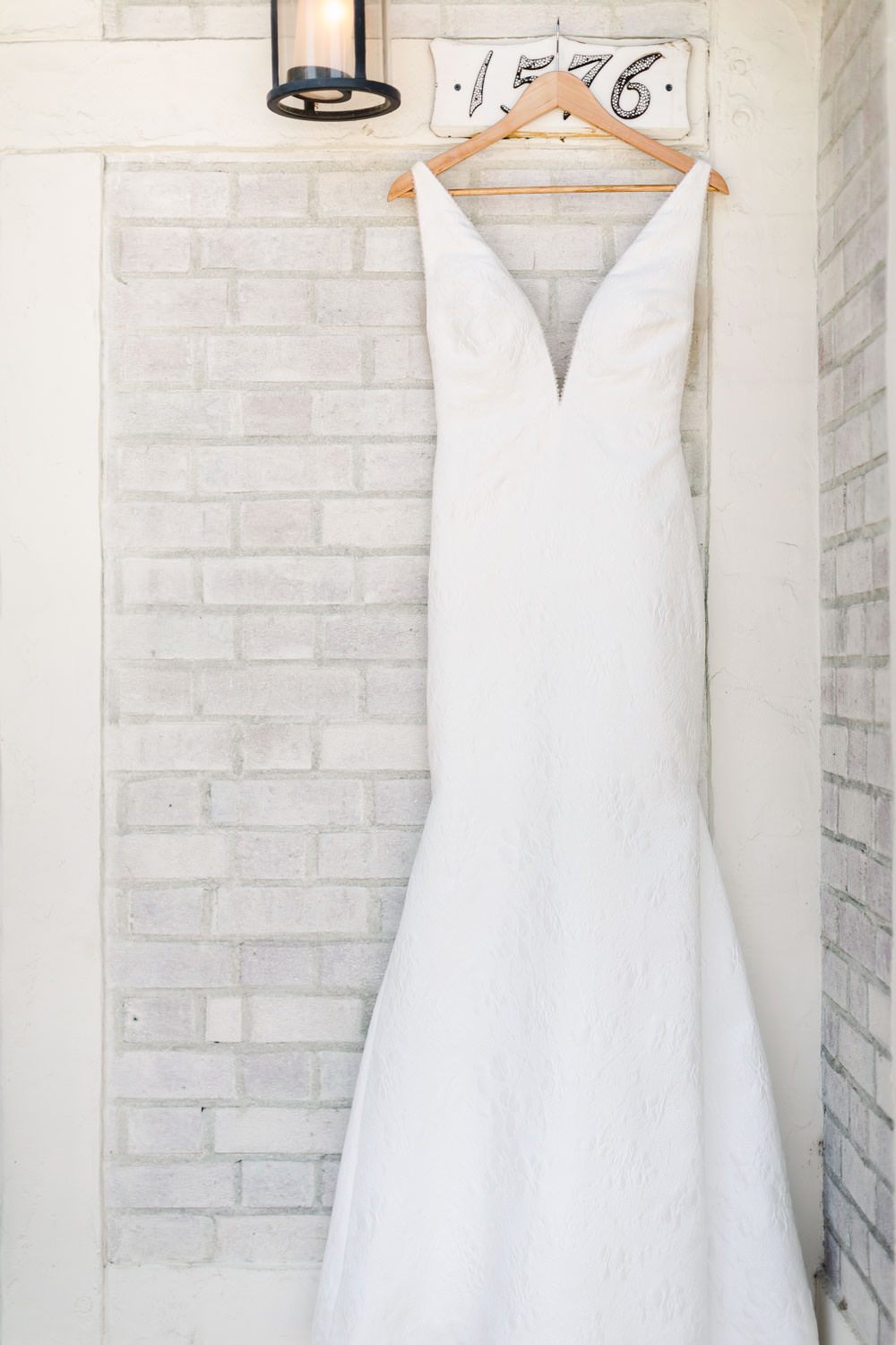 White sleeveless illusion neckline textured gown, Gainey Vineyards Wedding, Cavin Elizabeth Photography