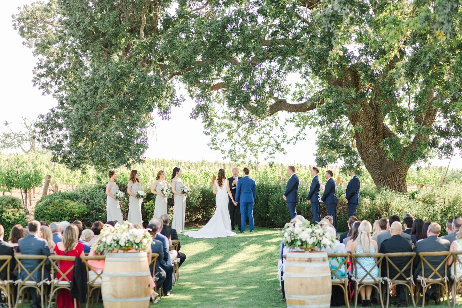 Gainey Vineyards wedding ceremony under the tree, Cavin Elizabeth Photography