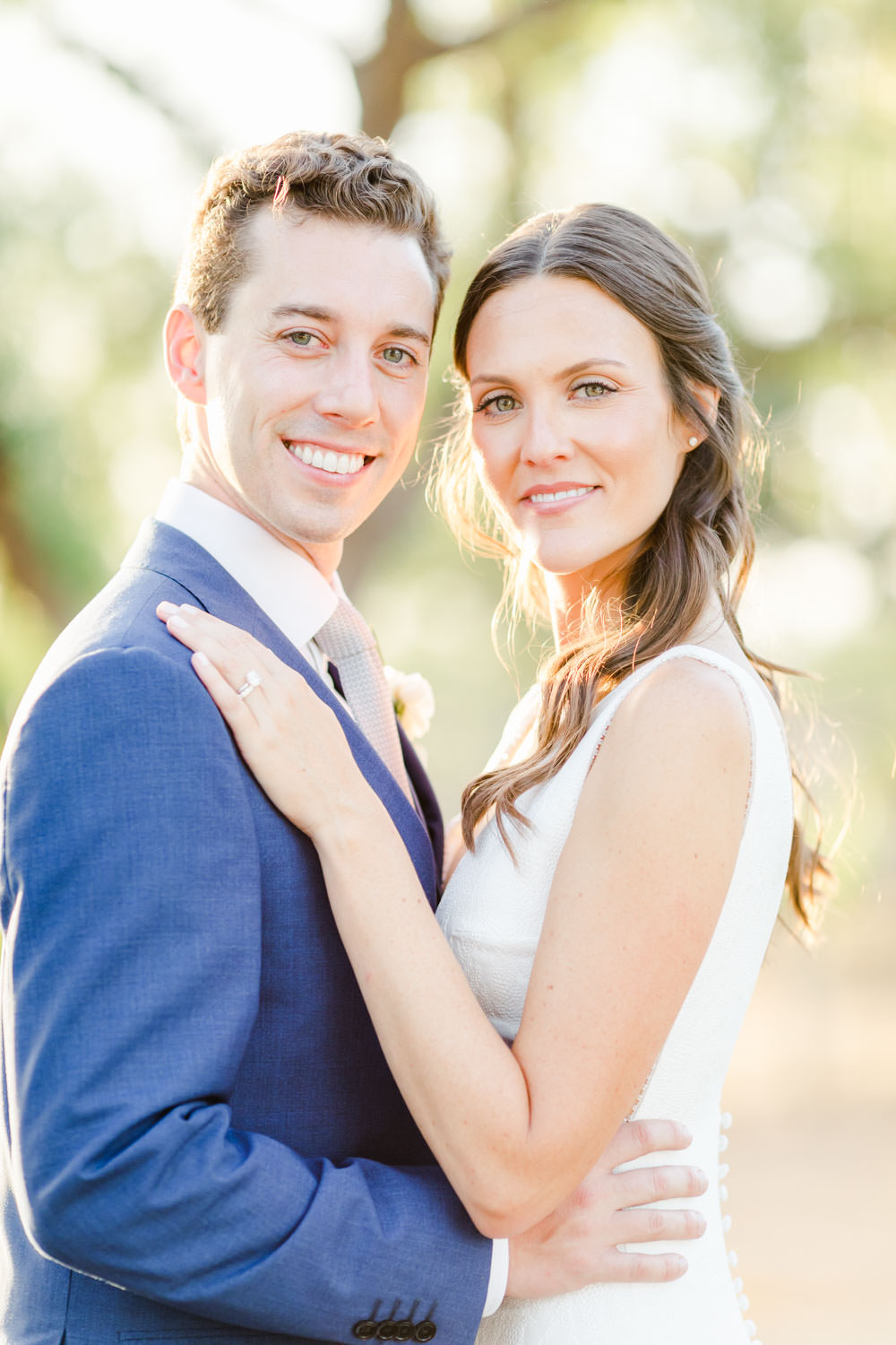 Bride and groom portrait around vineyard vines, Cavin Elizabeth Photography