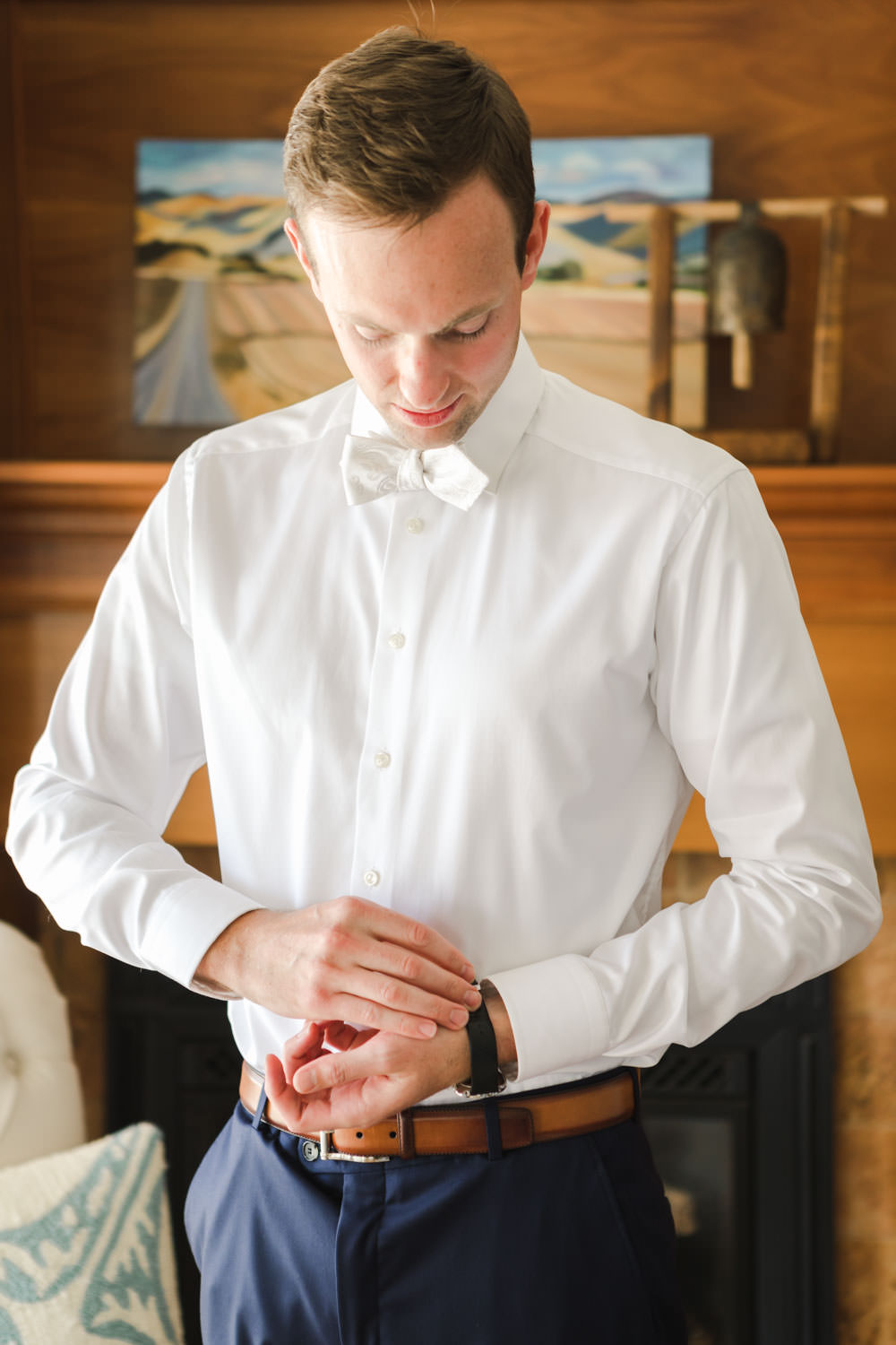 Groom putting on watch before wedding, Cavin Elizabeth Photography