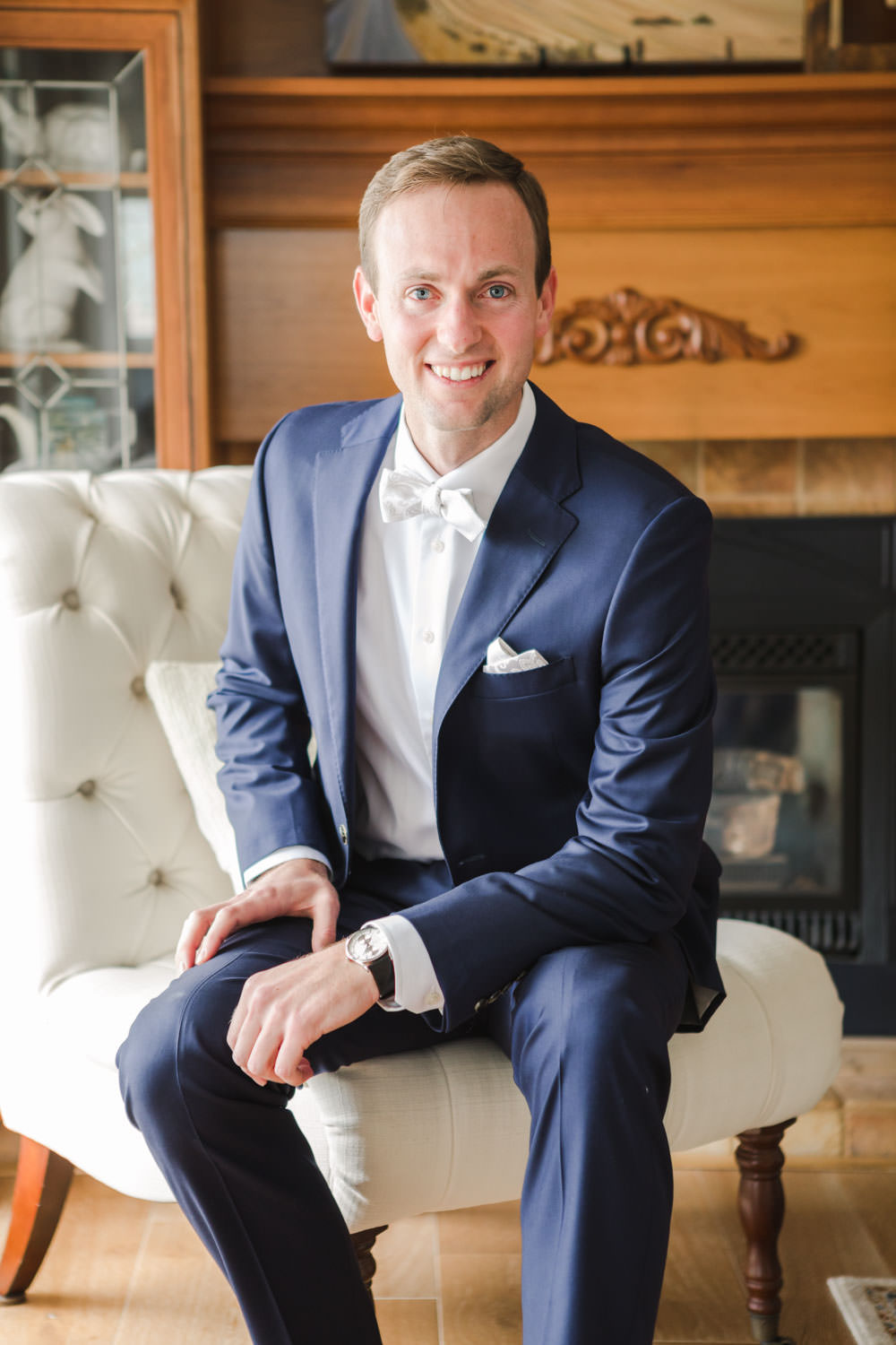 Groom indoor portrait in a navy suit, Cavin Elizabeth Photography