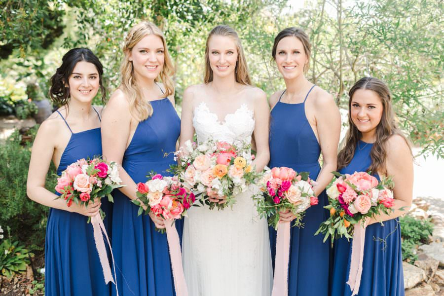 Bride with bridesmaids for a San Diego Botanic Garden wedding with blue and pink colors, Cavin Elizabeth Photography