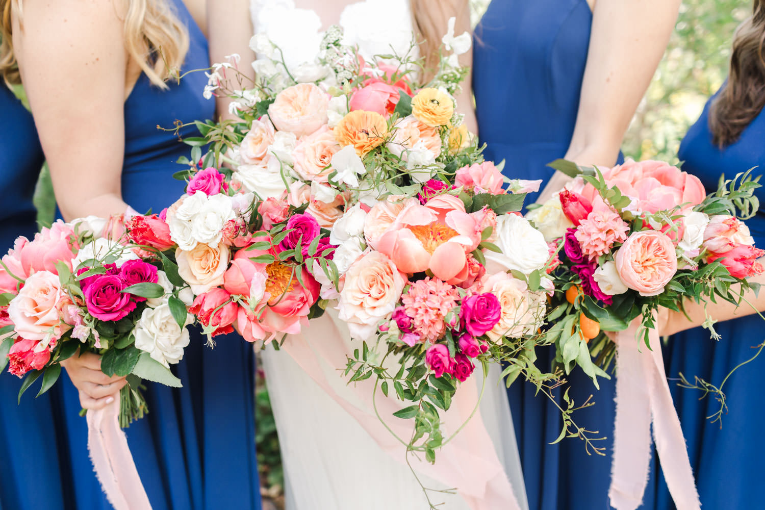 Bride with bridesmaids bouquets for a San Diego Botanic Garden wedding with blue and pink colors, Cavin Elizabeth Photography