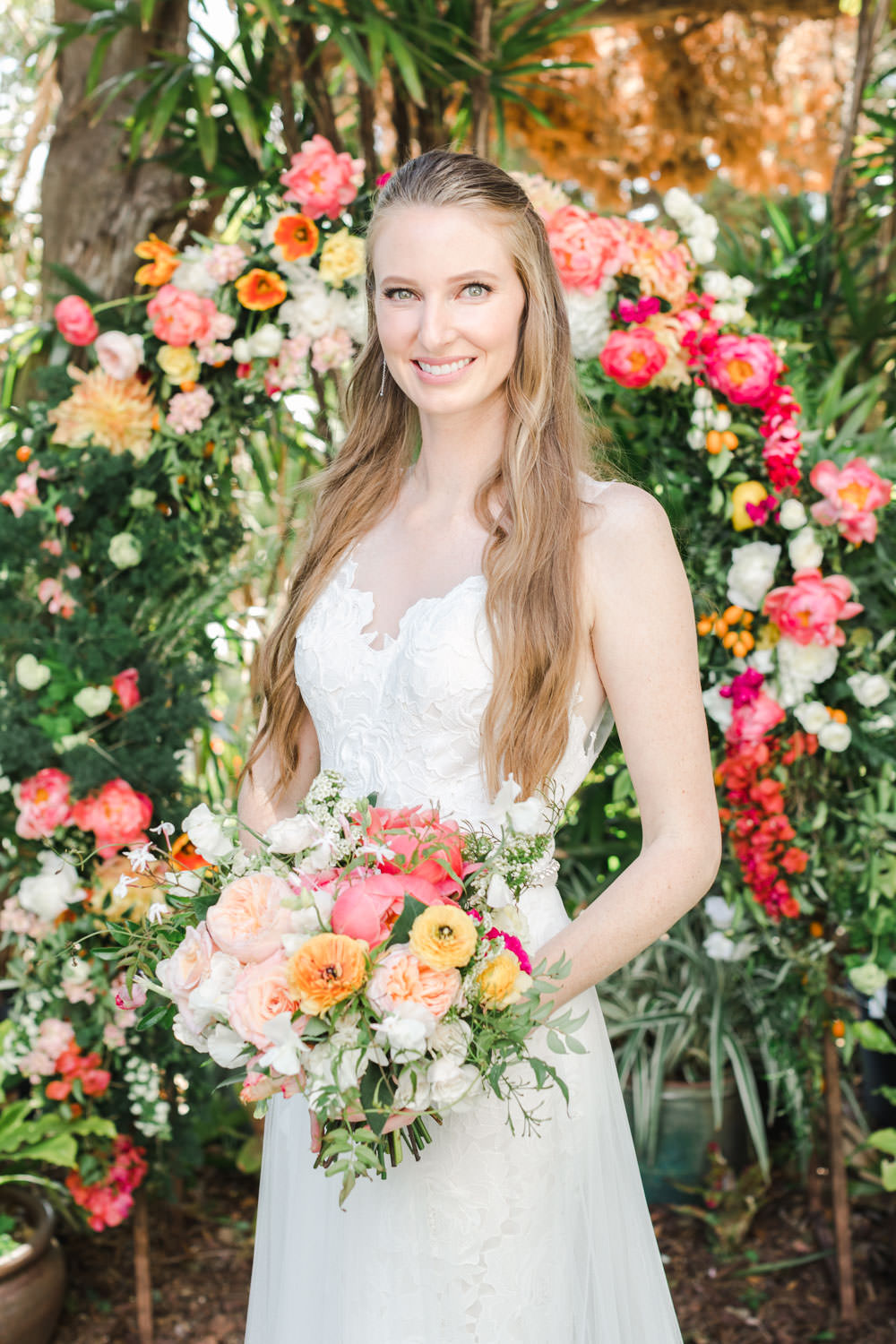 San Diego Botanic Garden wedding, Bride in front of floral arch, Bridal bouquet with pink peach yellow and green, Cavin Elizabeth Photography