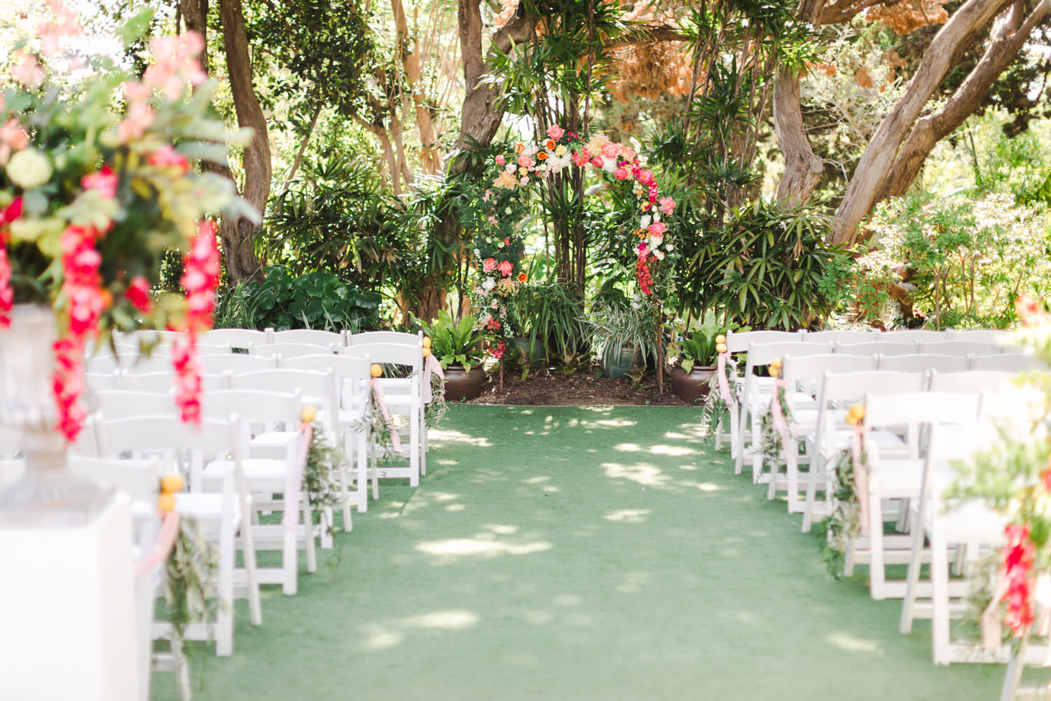 Ceremony floral arch for a San Diego Botanic Garden wedding with peach white green and pink colors, Cavin Elizabeth Photography