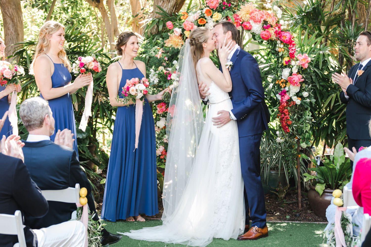 First kiss, Ceremony floral arch for a San Diego Botanic Garden wedding with peach white green and pink colors, Cavin Elizabeth Photography