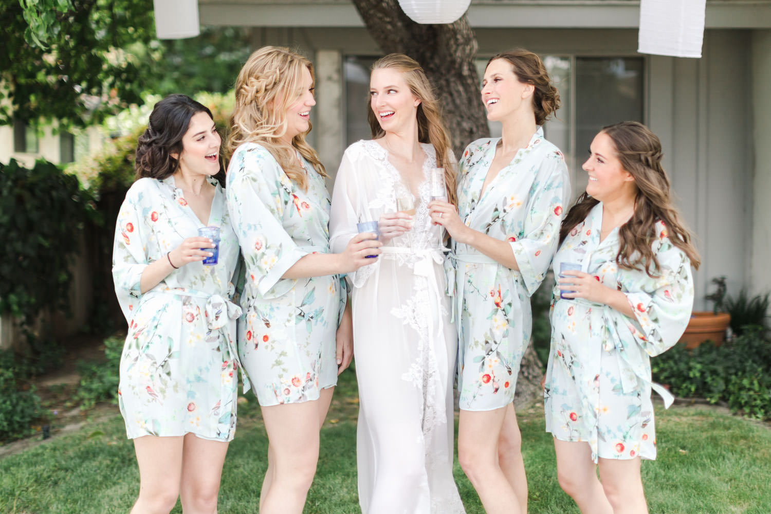 Bridesmaids in robes with champagne, Cavin Elizabeth Photography