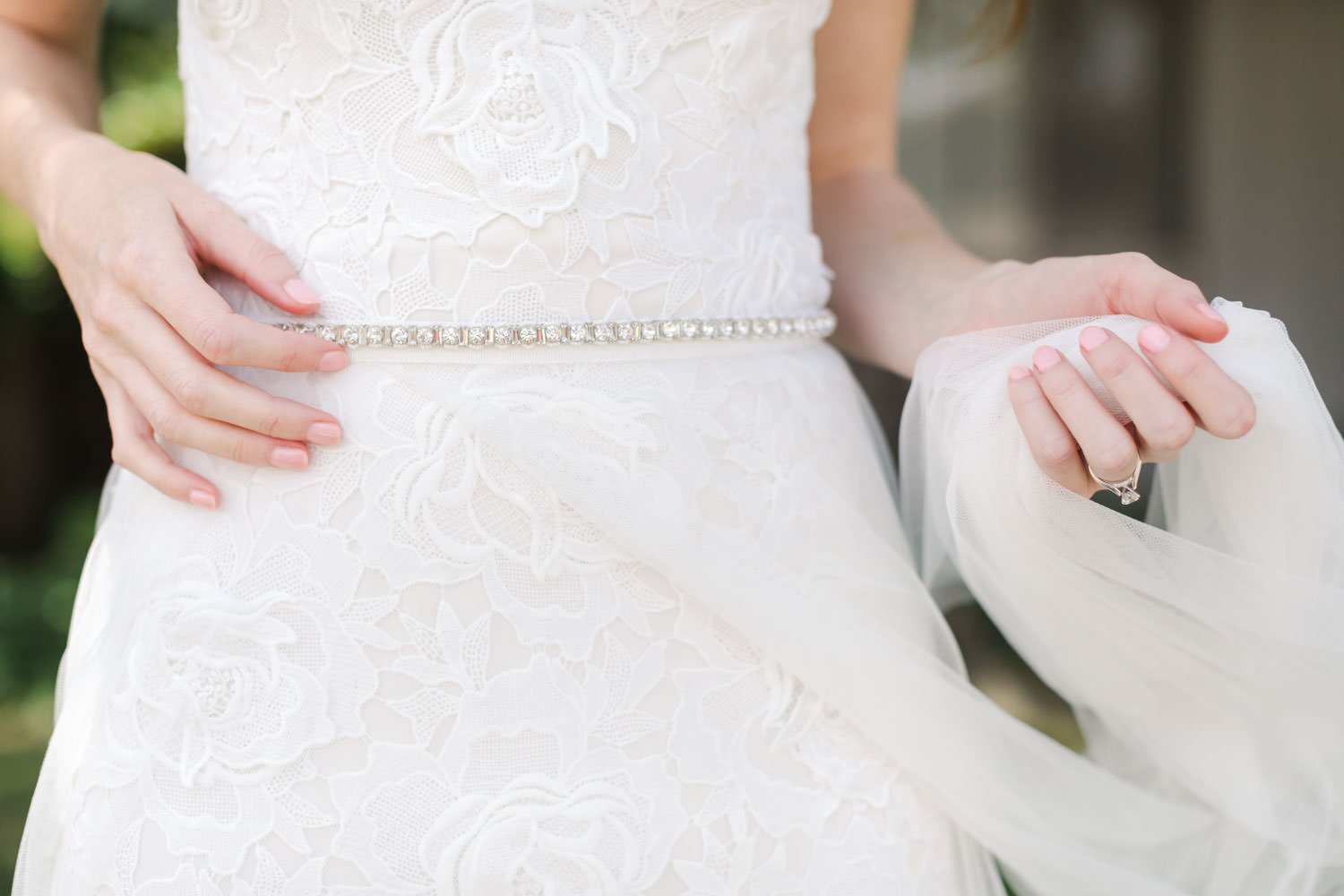 Bride holding her tulle overlay on her wedding gown, Cavin Elizabeth Photography