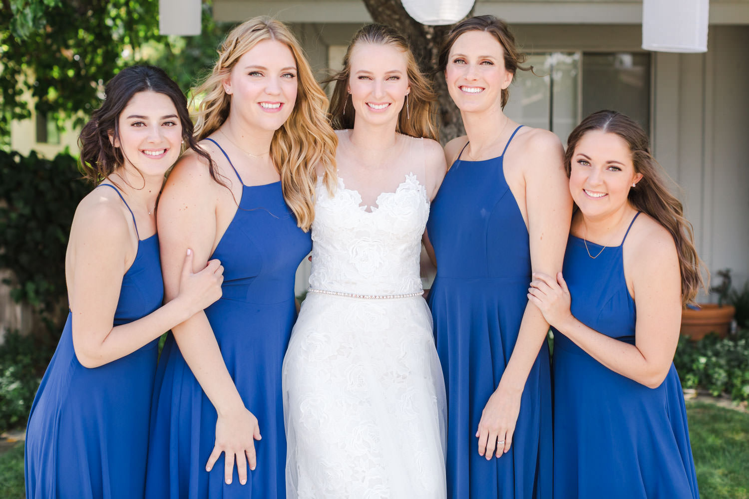 Bride with bridesmaids in blue dresses, Cavin Elizabeth Photography