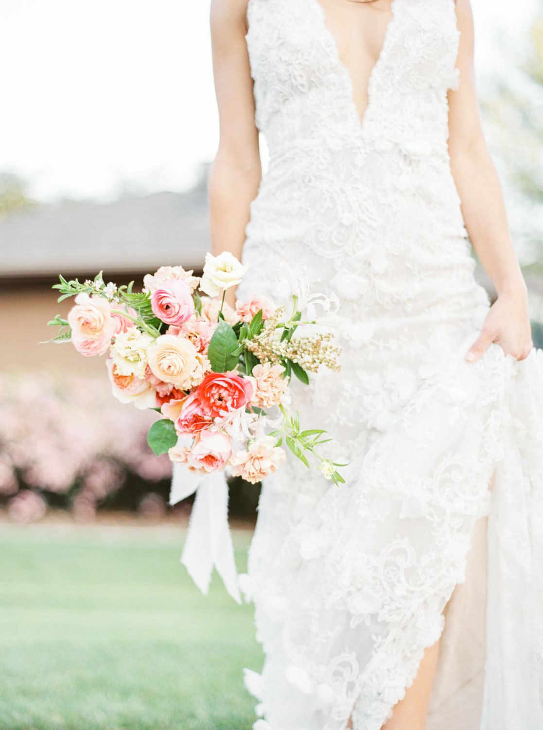 Bride in Marchesa Daffodil gown, Bridal bouquet with apricot peach blush pink and green, Film by Cavin Elizabeth Photography
