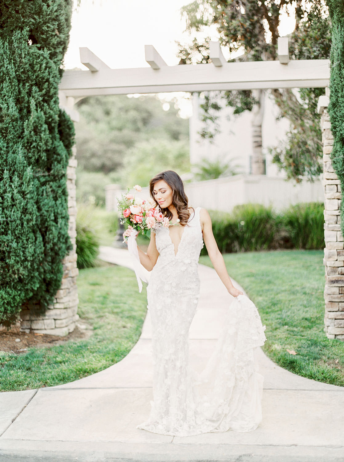 San Diego bridal portraits at a private estate, Bride in Marchesa Daffodil gown, Bridal bouquet with apricot peach blush pink and green, Film by Cavin Elizabeth Photography