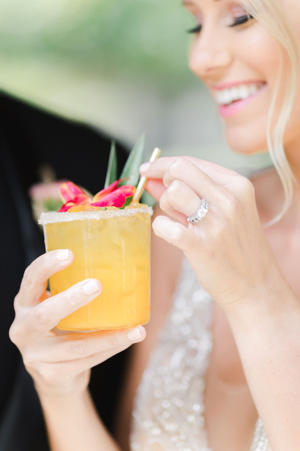 Bride holding passion fruit cocktail at her wedding, Cavin Elizabeth Photography