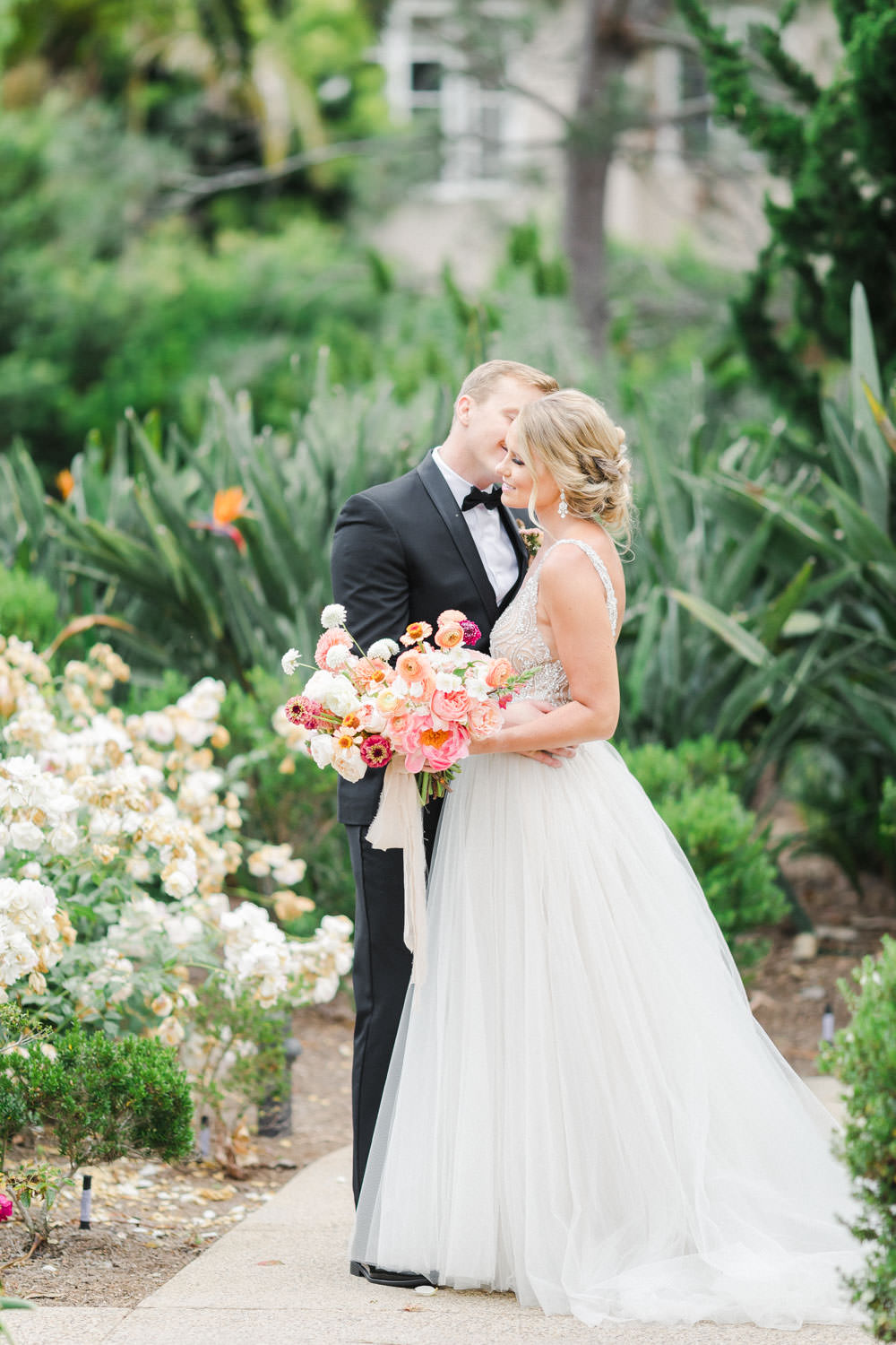 Bride and groom portrait with Pink peach violet and white bridal bouquet, Wedding at Estancia La Jolla, Cavin Elizabeth Photography