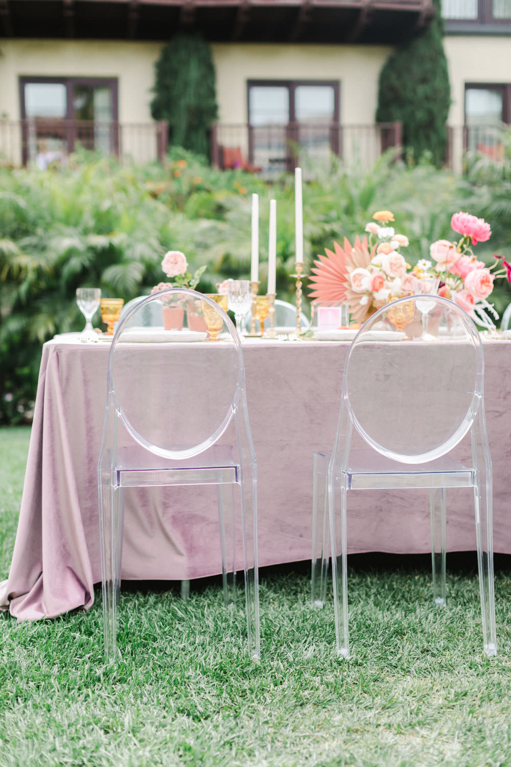 Ghost chairs at Rose quartz velvet linen table with orange glassware and marble dinnerware, Pink peach violet and white floral arrangement, Wedding at Estancia La Jolla, Cavin Elizabeth Photography