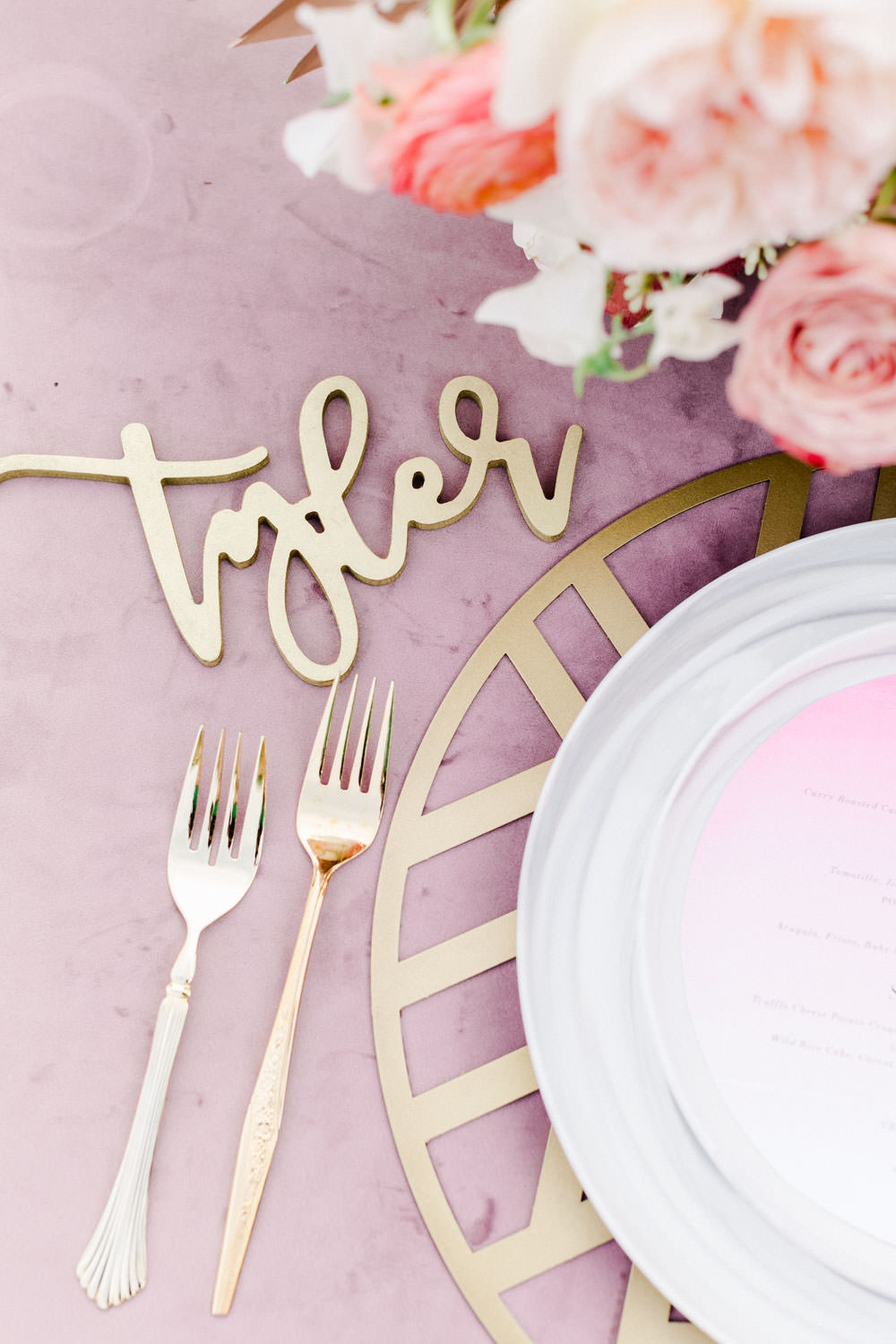 Gold laser cut wooden name card place setting, Rose quartz velvet linen table with orange glassware and marble dinnerware, Pink peach violet and white floral arrangement, Wedding at Estancia La Jolla, Cavin Elizabeth Photography