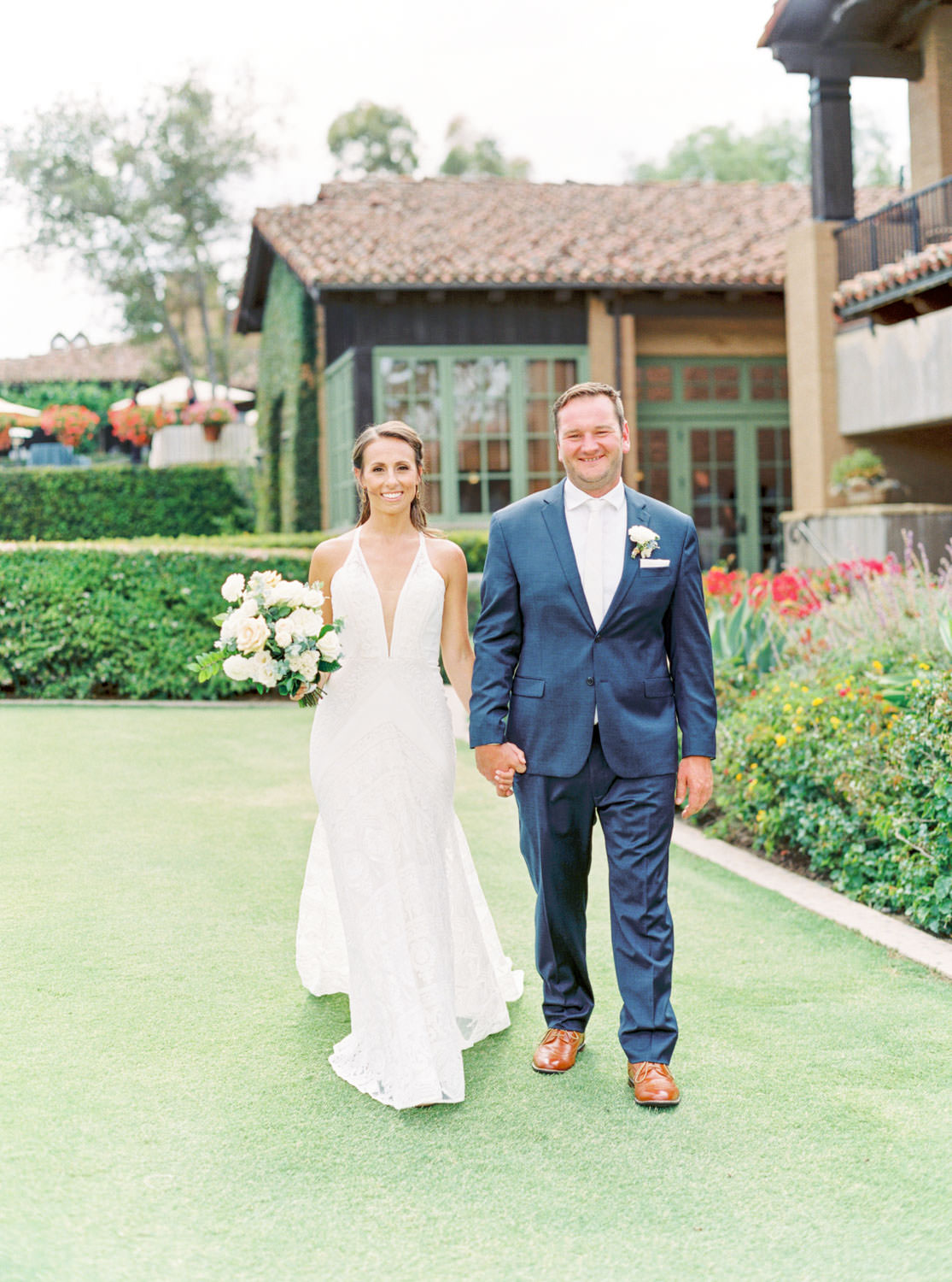 Bride and groom portrait in a Rue de Seine gown, White green and blue wedding at the Santaluz Club, film by Cavin Elizabeth Photography