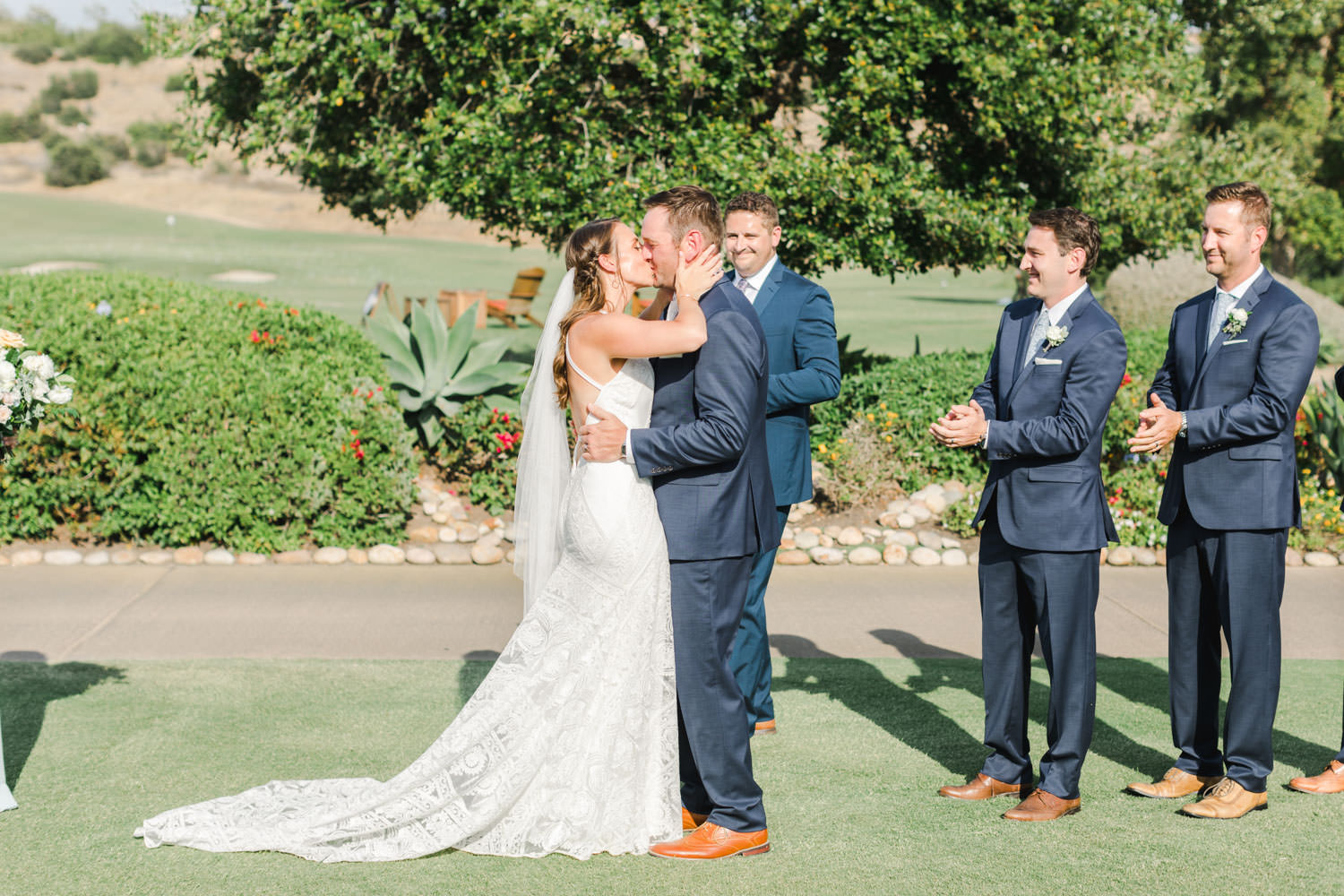 First kiss at Santaluz Club Golf course wedding ceremony with a view, Cavin Elizabeth Photography