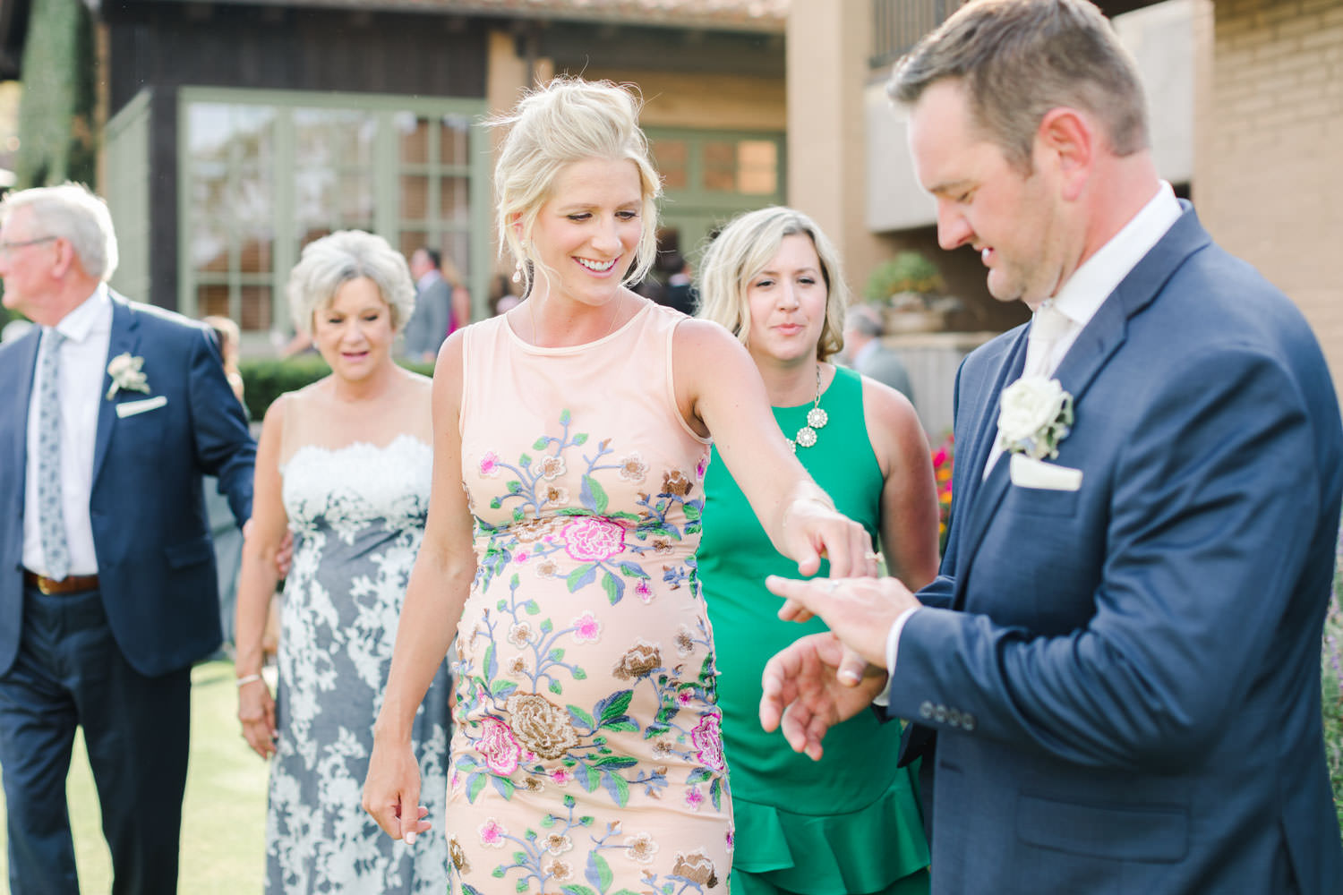 Guests looking at groom's new ring, Cavin Elizabeth Photography