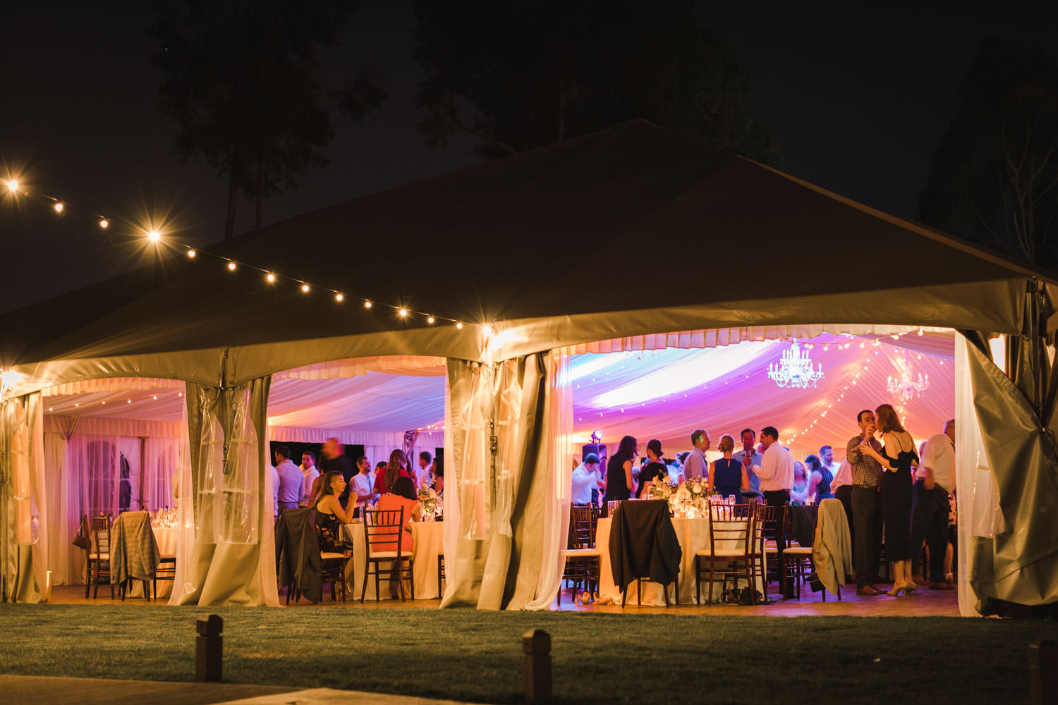 Santaluz Club wedding reception at night with tent and uplights, Cavin Elizabeth Photography