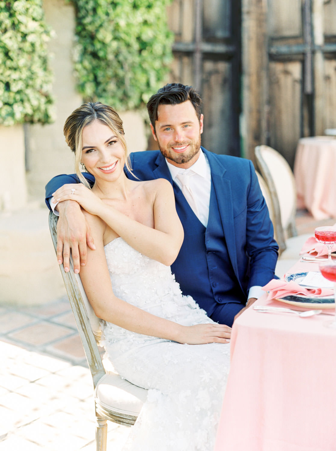 Whispering Rose Ranch wedding on film, bride and groom sitting at reception table in a Marchesa gown, Cavin Elizabeth Photography