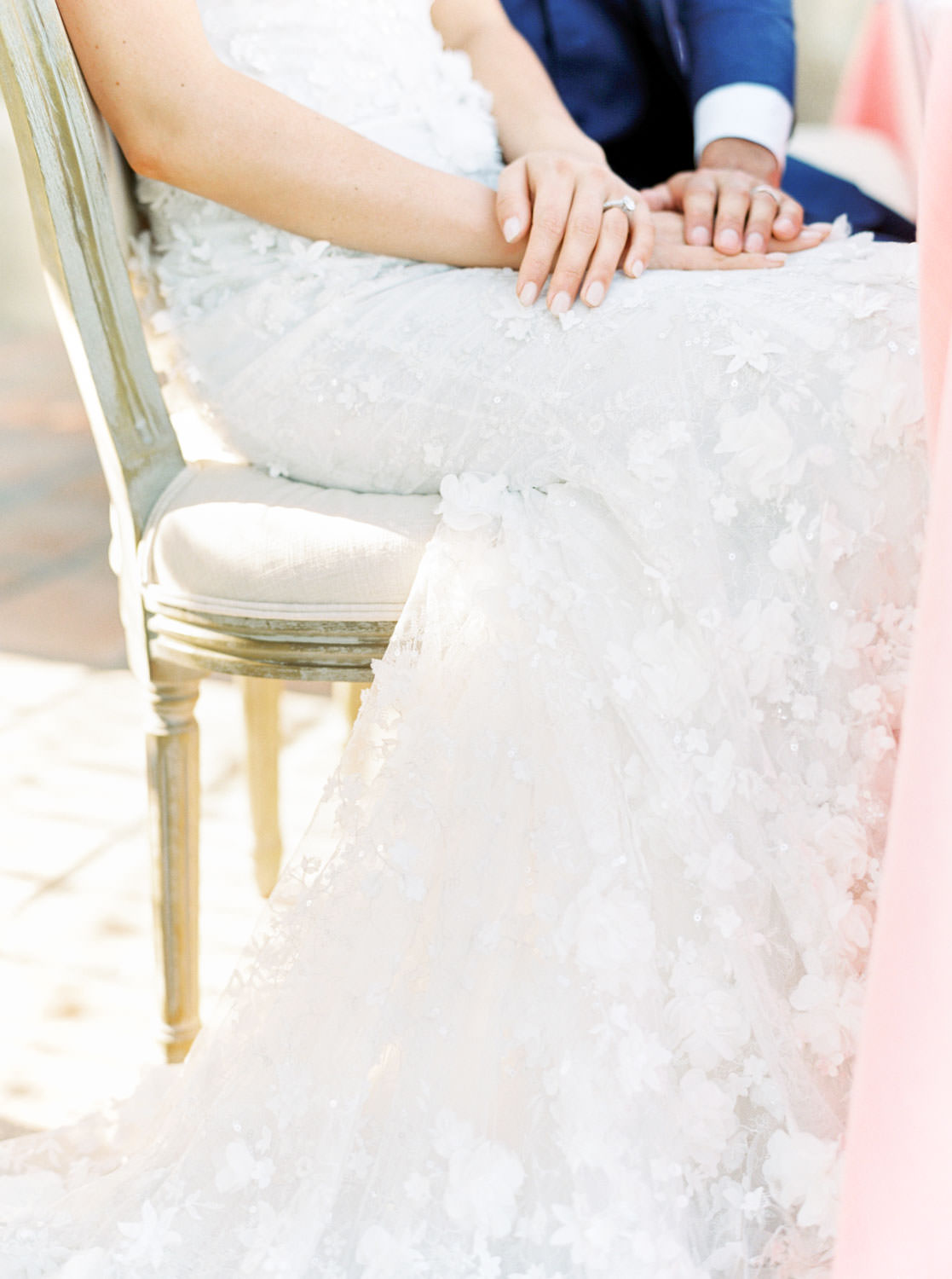 bride sitting at reception table in a Marchesa gown, Cavin Elizabeth Photography