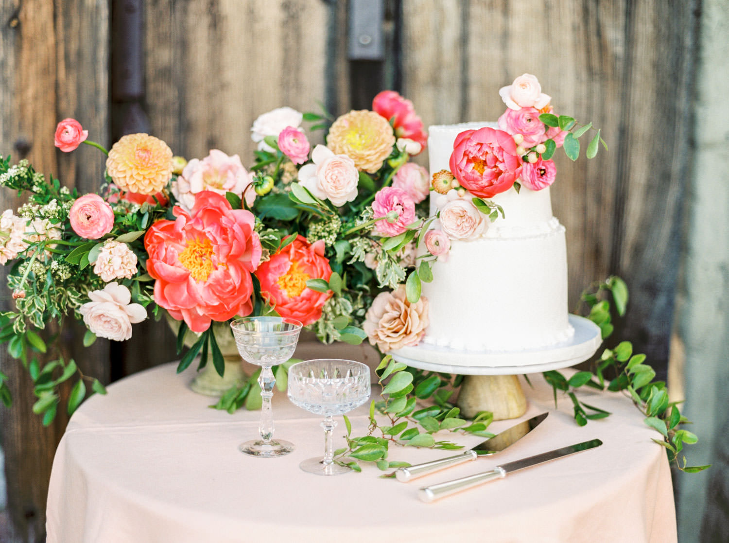 Film image of Two tier white wedding cake with coral charm peonies and yellow and blush flowers, Cavin ELizabeth Photography