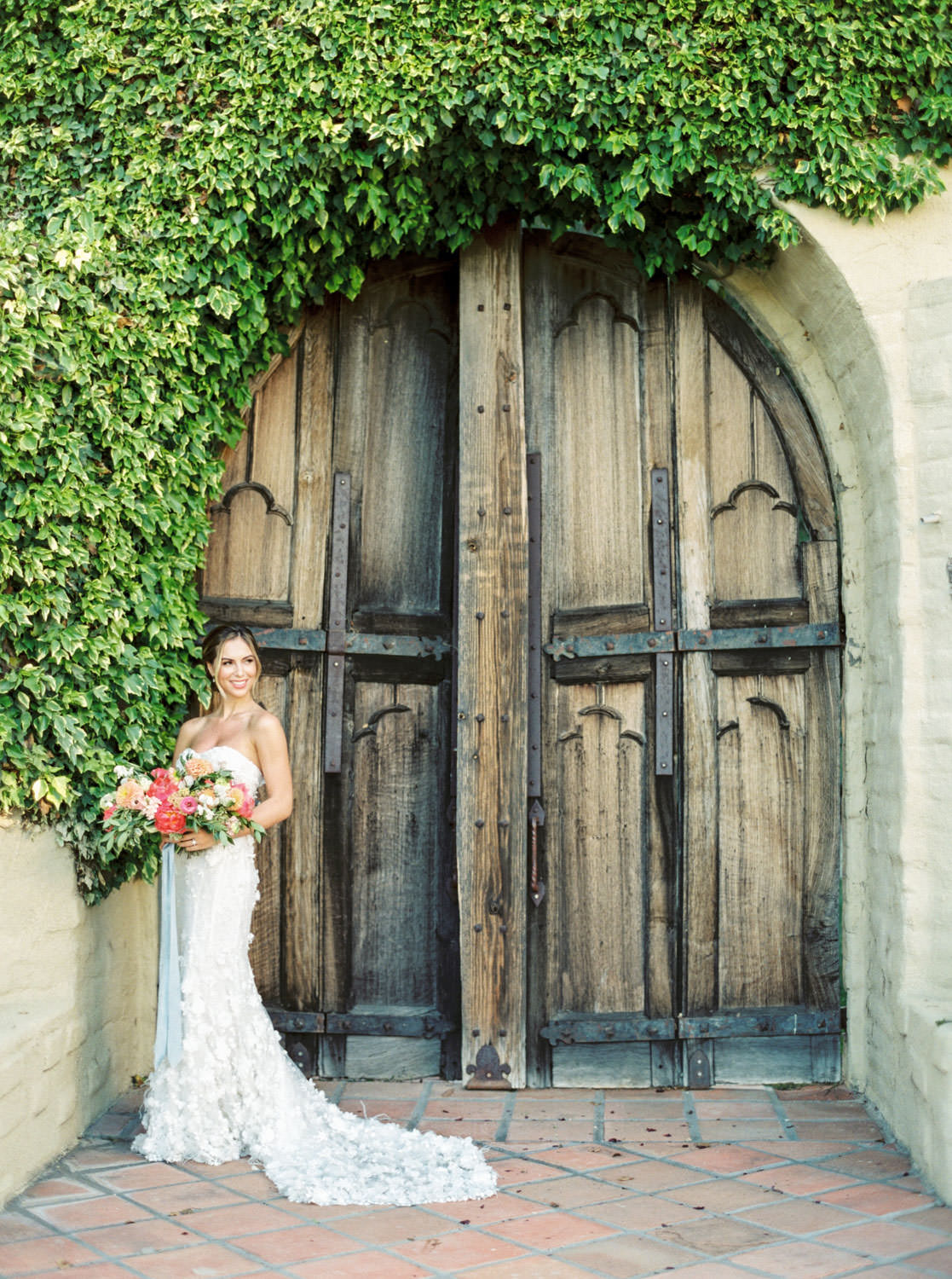 Bride with pink green and yellow bouquet at Whispering Rose Ranch wedding with Marchesa gown shot on film, Cavin Elizabeth Photography