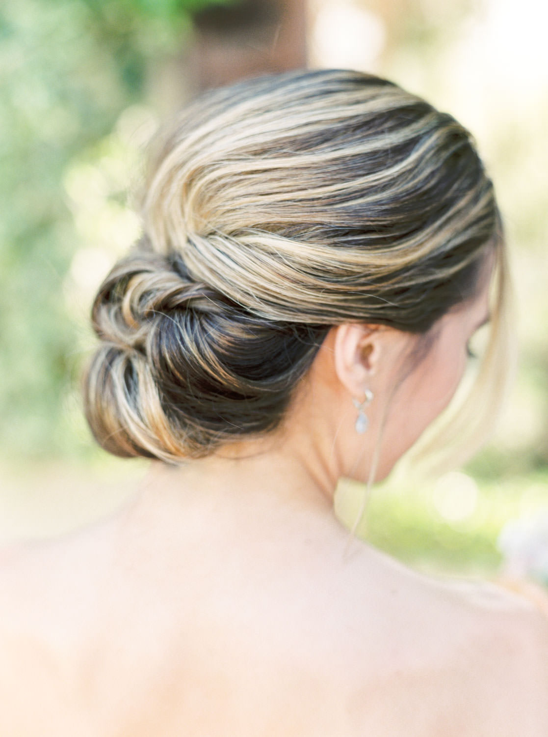 Bride with chic low braided chignon by Janet Villa at Whispering Rose Ranch, film by Cavin Elizabeth Photography